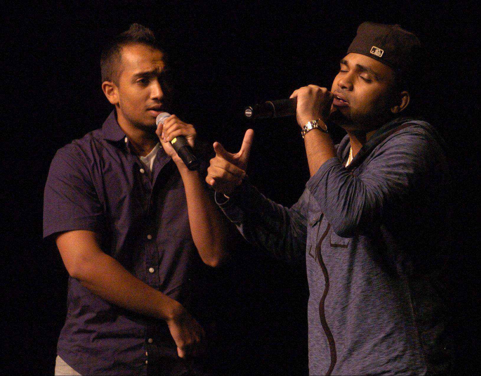 Shawn Kurian of Wheeling, left, and Sanu John of Skokie doing their two-man a cappella during Suburban Chicago's Got Talent at the Metropolis Performing Arts Centre.