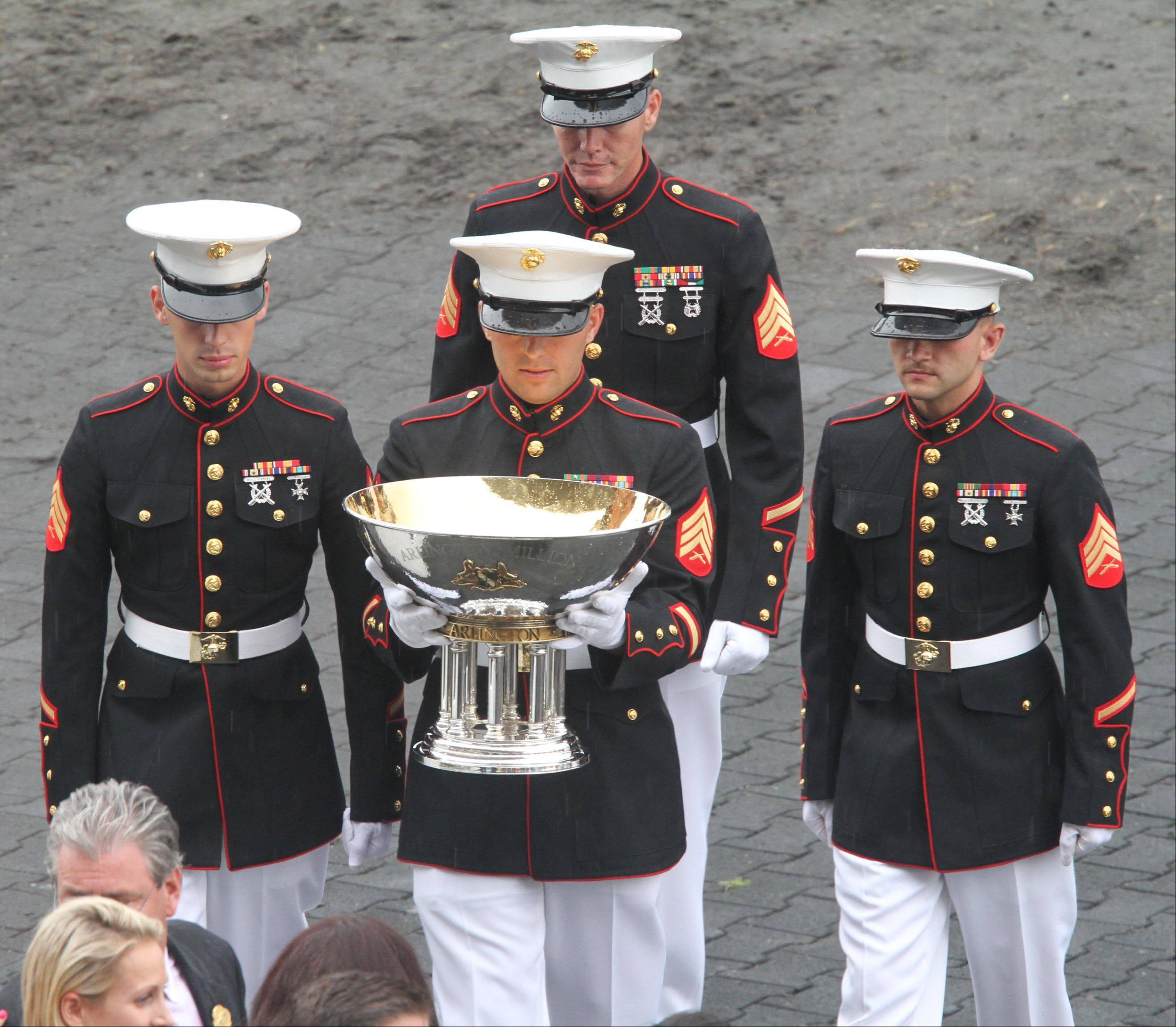 A Marine color guard appears with the Arlington Million trophy.