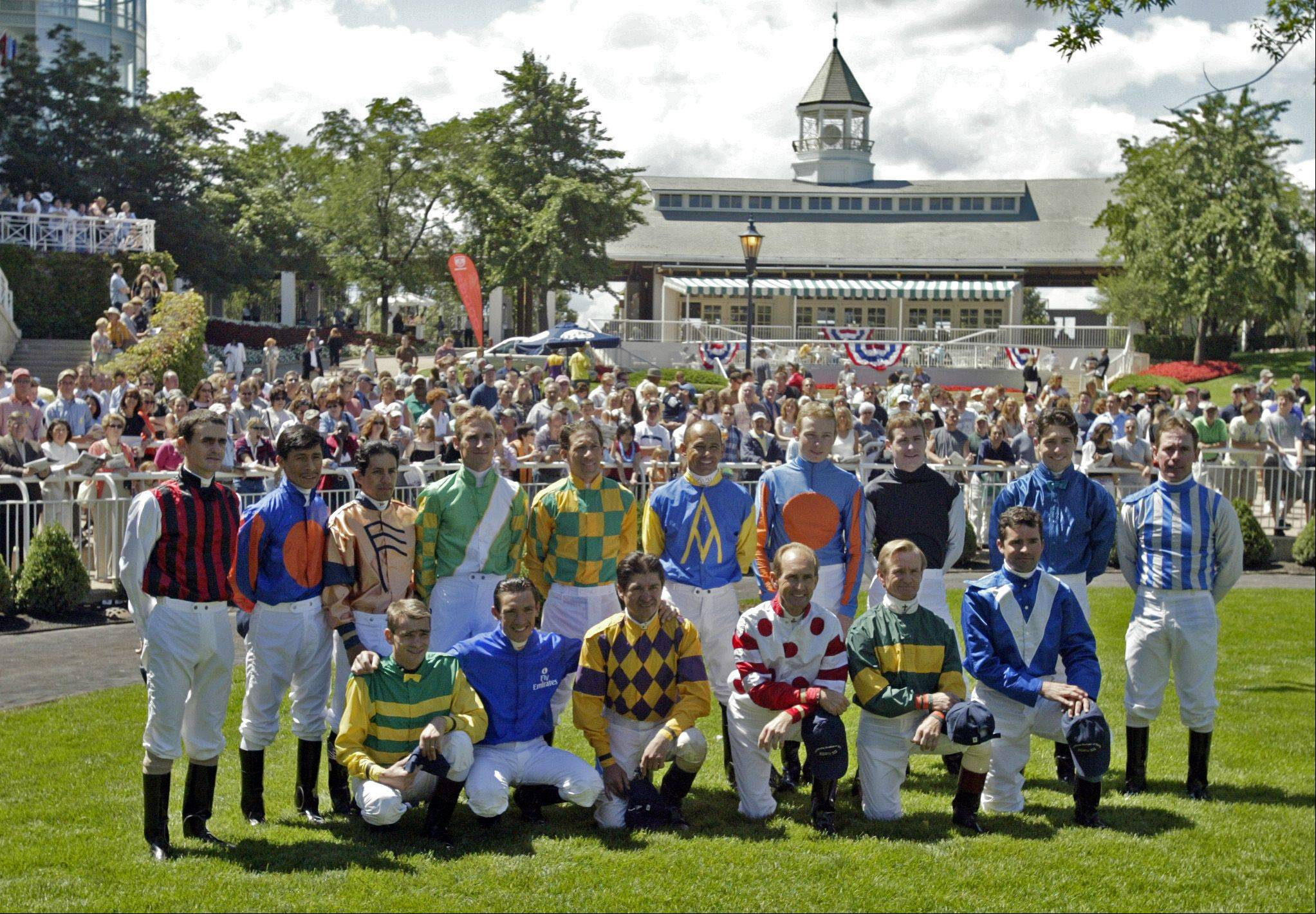 Arlington Festival of racing jockeys pose for a photo after opening ceremonies during the 22nd annual running of the Arlington Million.