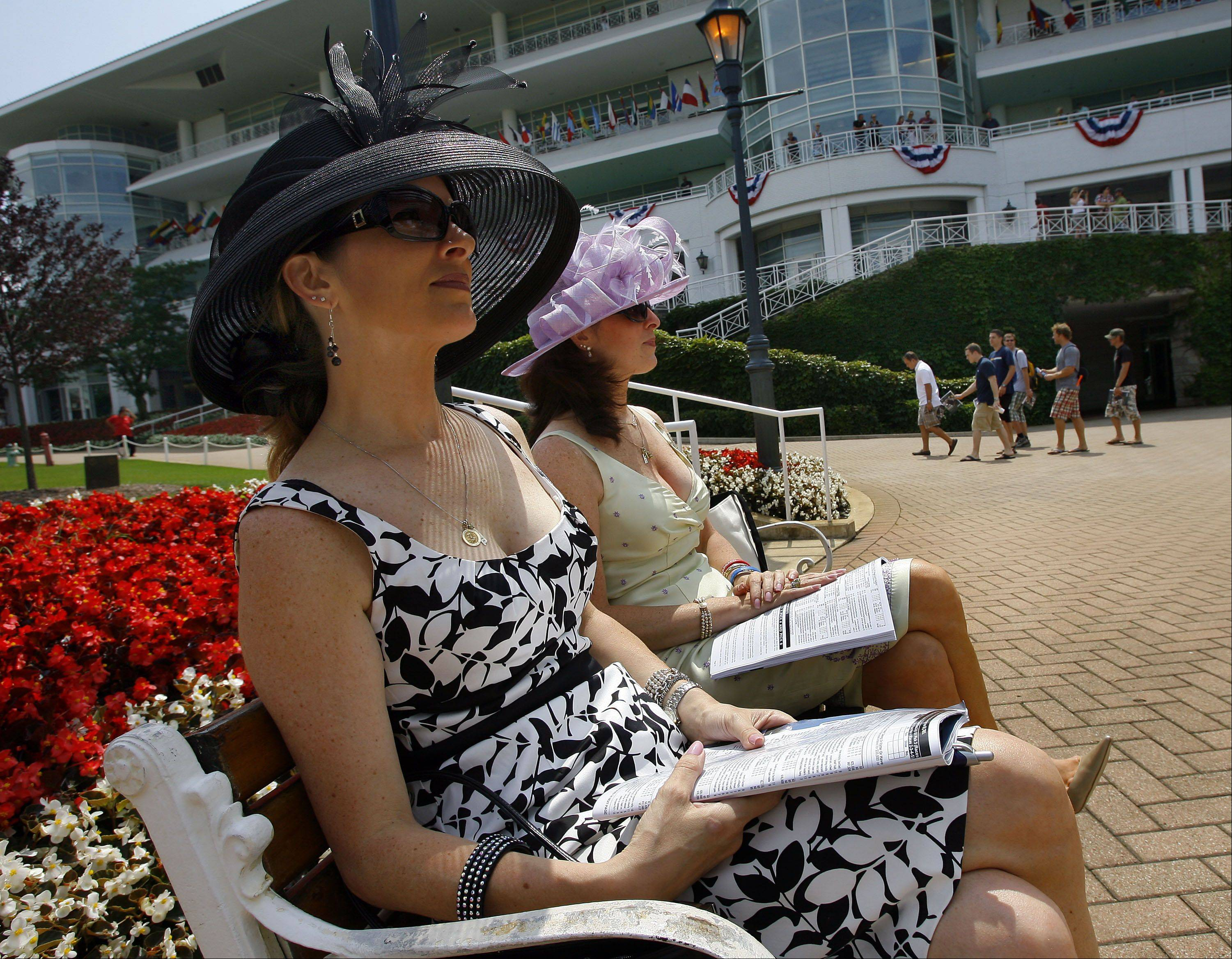 From left, Donna Ludvik and her sister Dora Petrulis relax before the start of the 27th running of the Arlington Million horse race at Arlington Park Race Track Saturday, Aug. 8, 2010, in Arlington Heights, Ill.