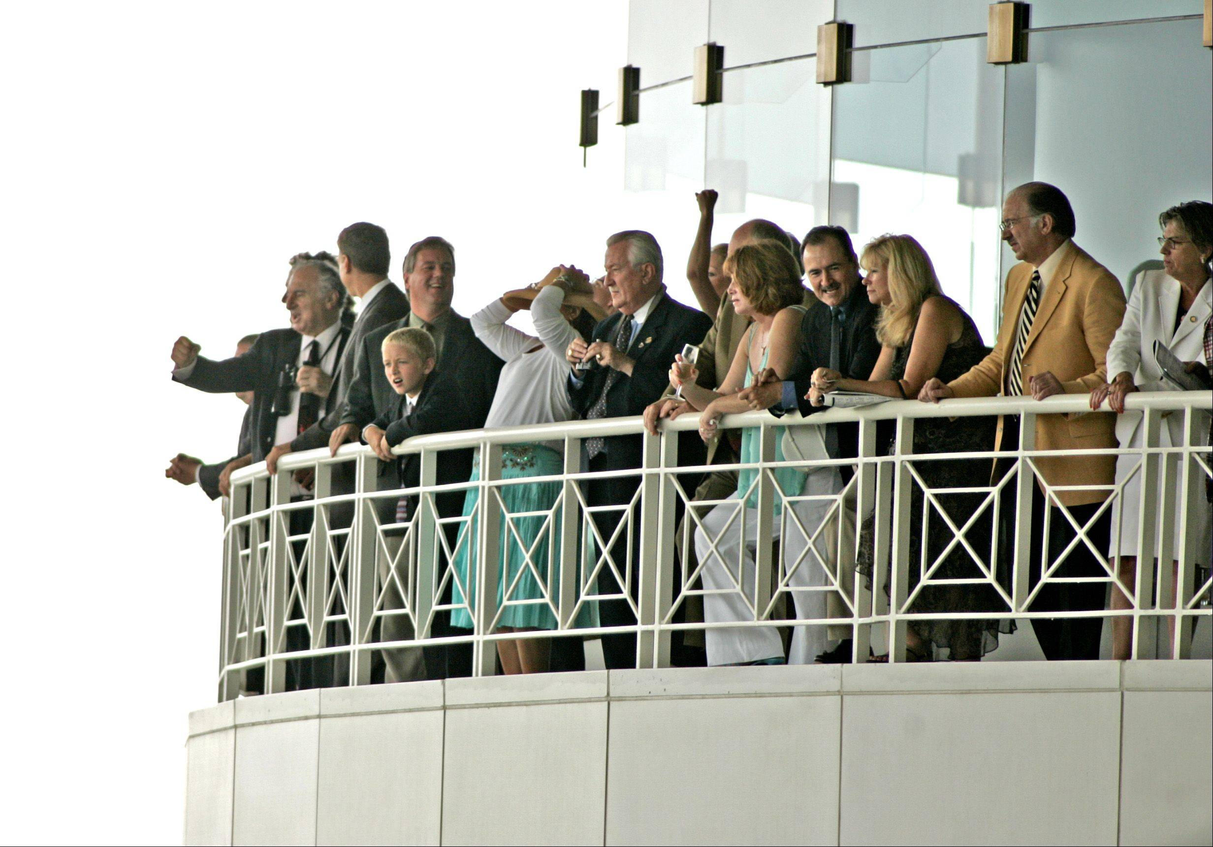 Fans celebrate during the 2005 Arlington Million