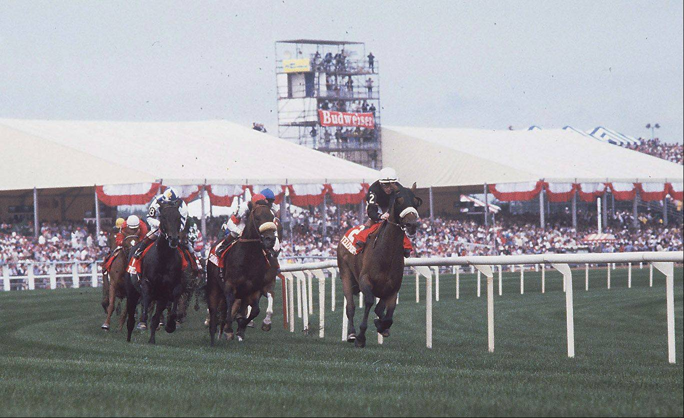 Horses round the track during the running of the Miracle Million at Arlington Park on August 25,1985. Tents and bleachers replaced the old grandstand after the fire in July.