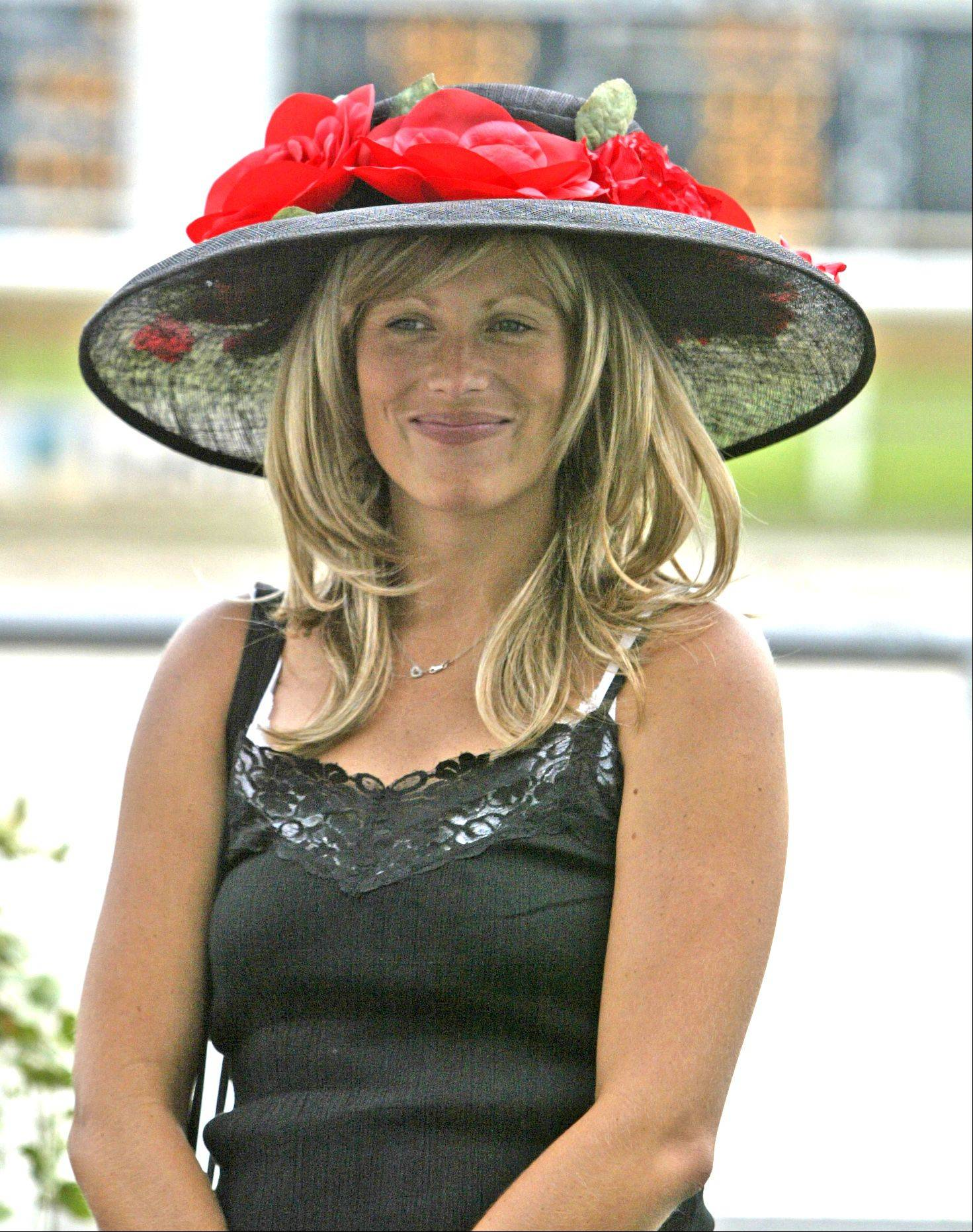 "Dena Jetel of Algonquin wins ""Best Fashion"" during the Arlington Million Ladies hat contest held at Arlington Park."
