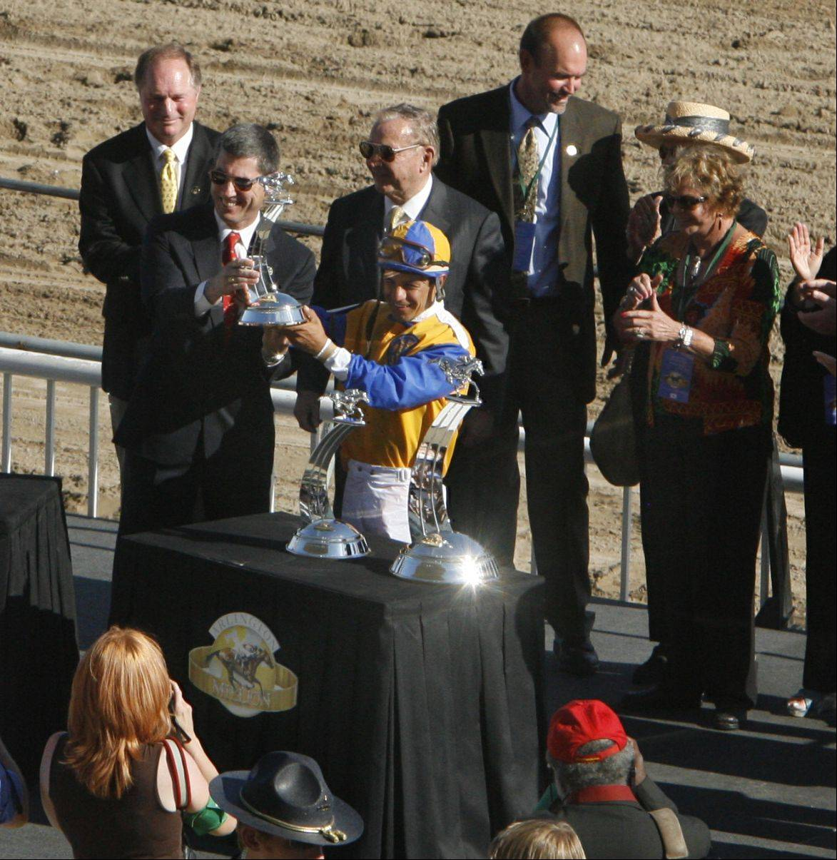Winning jocky Victor Espinoza gets his trophy for the 24th running of the Arlington Million.