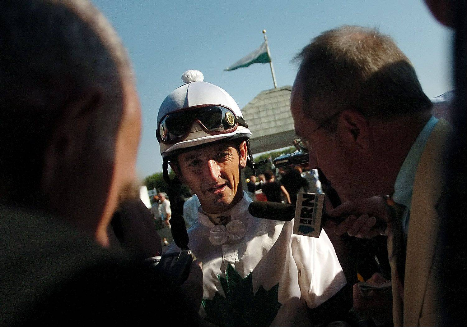 Robby Albarado is targeted by reporters after winning the Arlington Million.