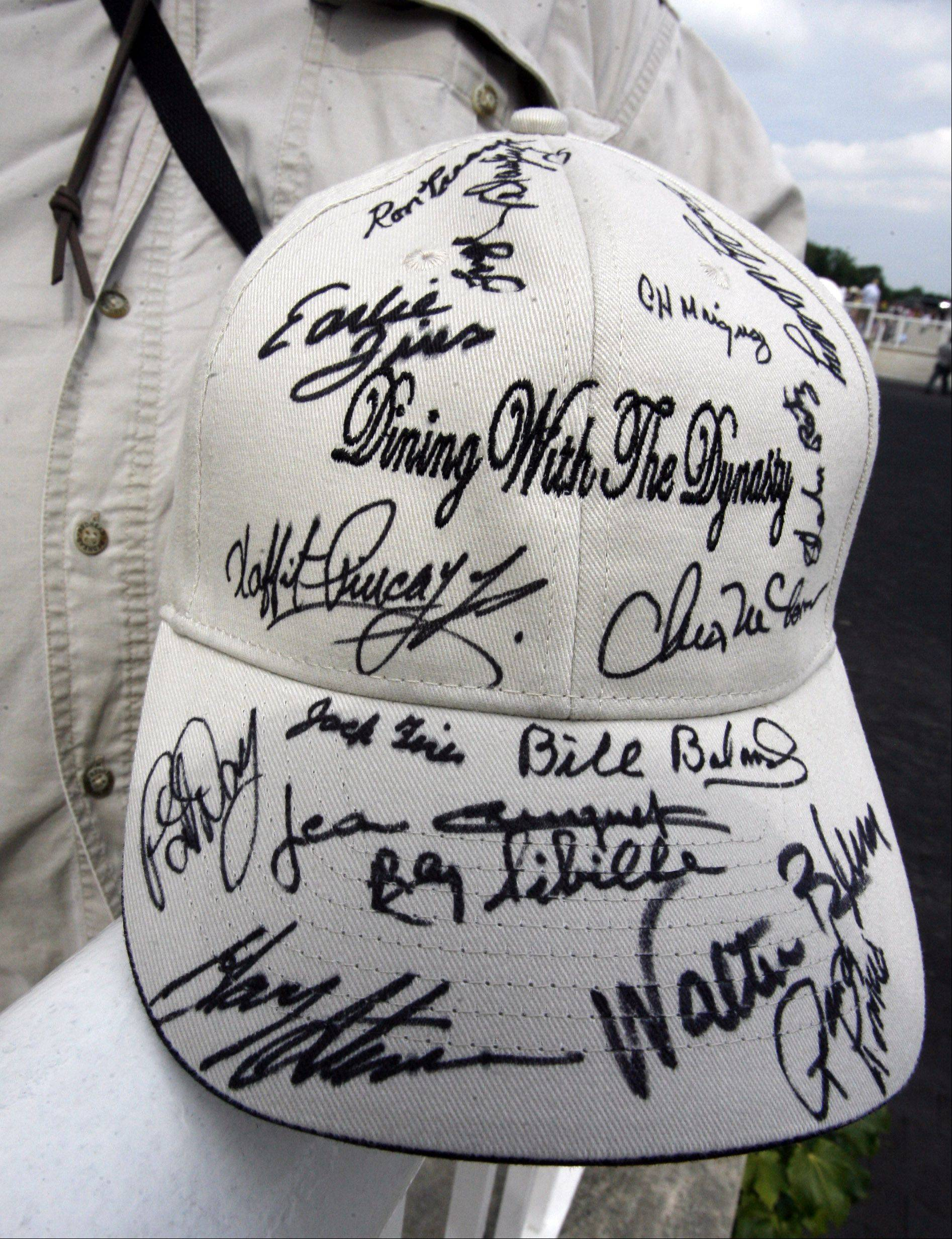 Mike Polk of Park Ridge brought his lucky jockey autographed hat to hold during the 27th Arlington Million .