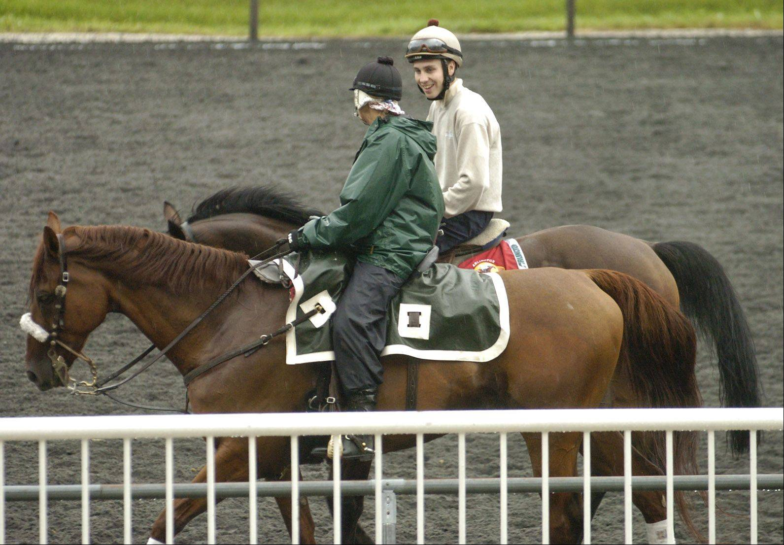Arlington Million entrant Afsare, right, works out on the track Thursday morning.