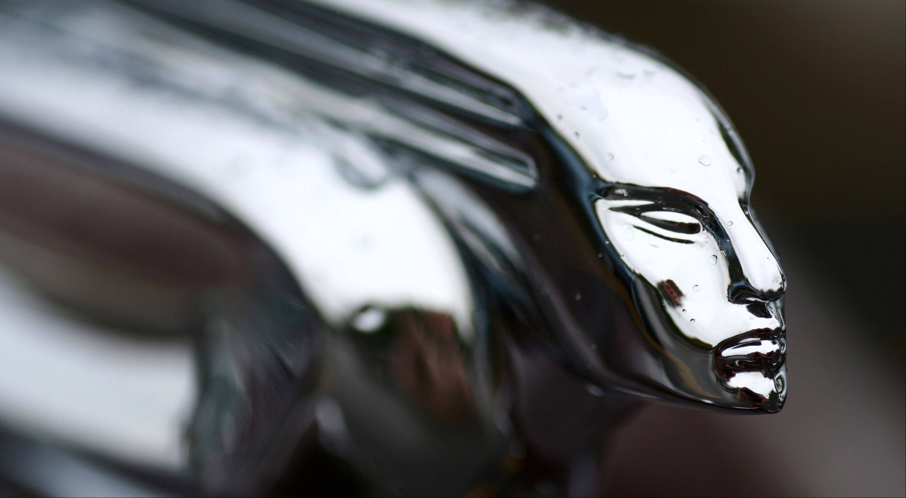 I photographed this vintage hood ornament at Cantigny's annual car show last fall. I used a macro lens to capture the detail of the stains on the metal from the fresh rain drops.