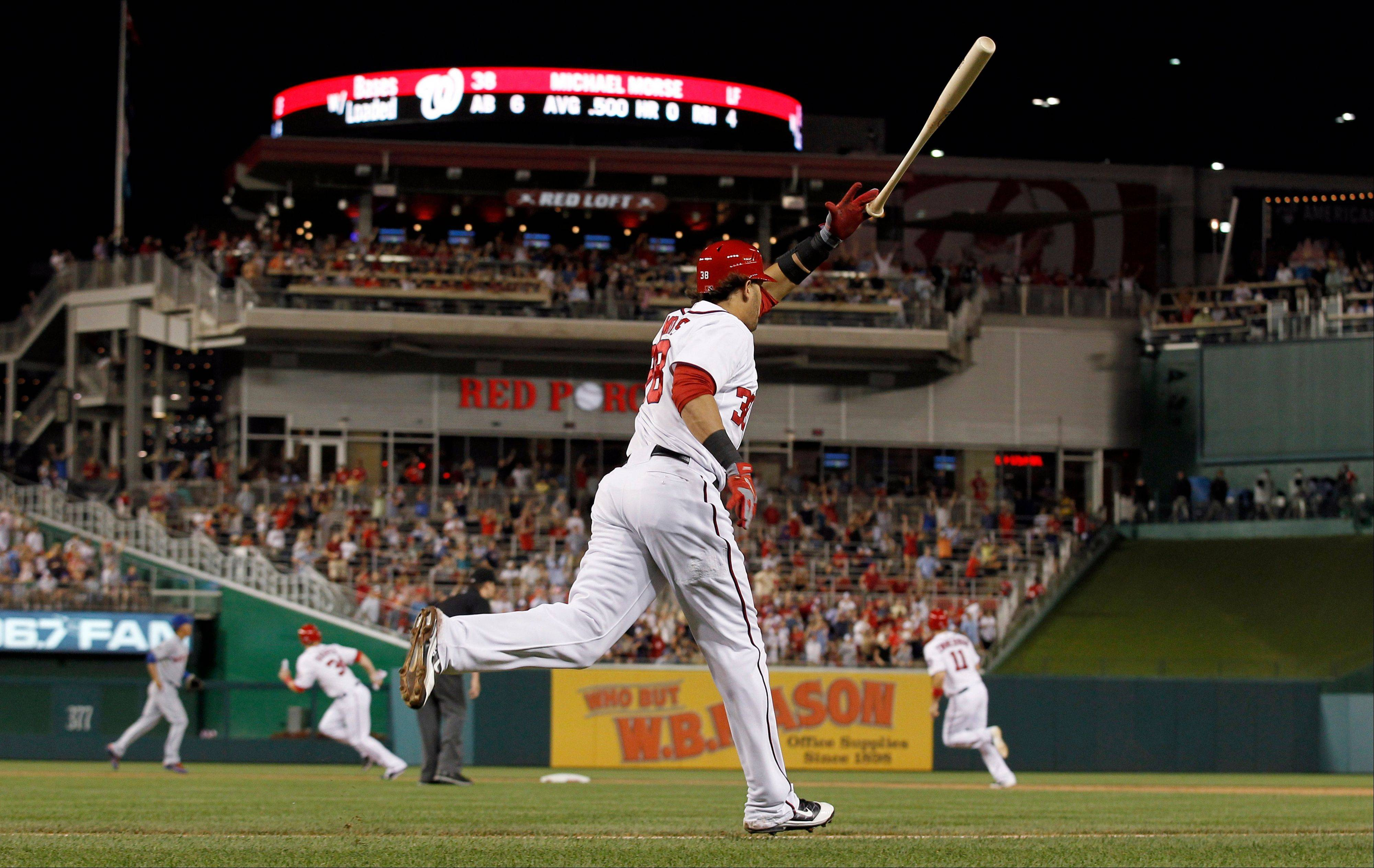 The Nationals' Michael Morse tosses his bat as he runs to first base on a grand slam during the fourth inning Friday at home against the Mets.
