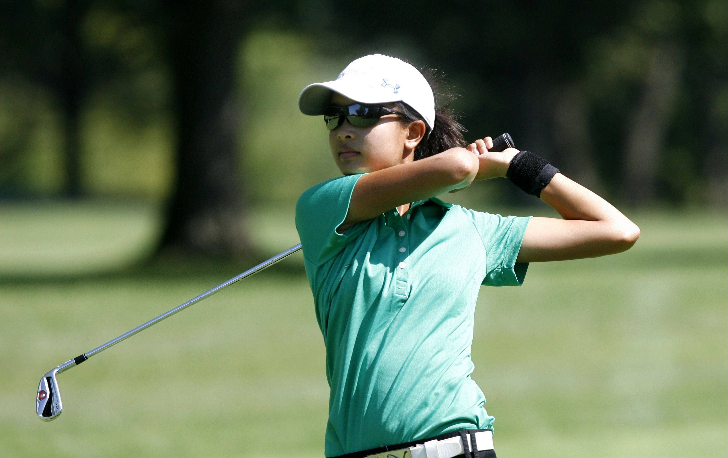 Waubonsie Valley's Bing Singhsumalee approaches the green, during the Vern McGonagle Memorial High School Golf Championship, held at the Naperville Country Club.