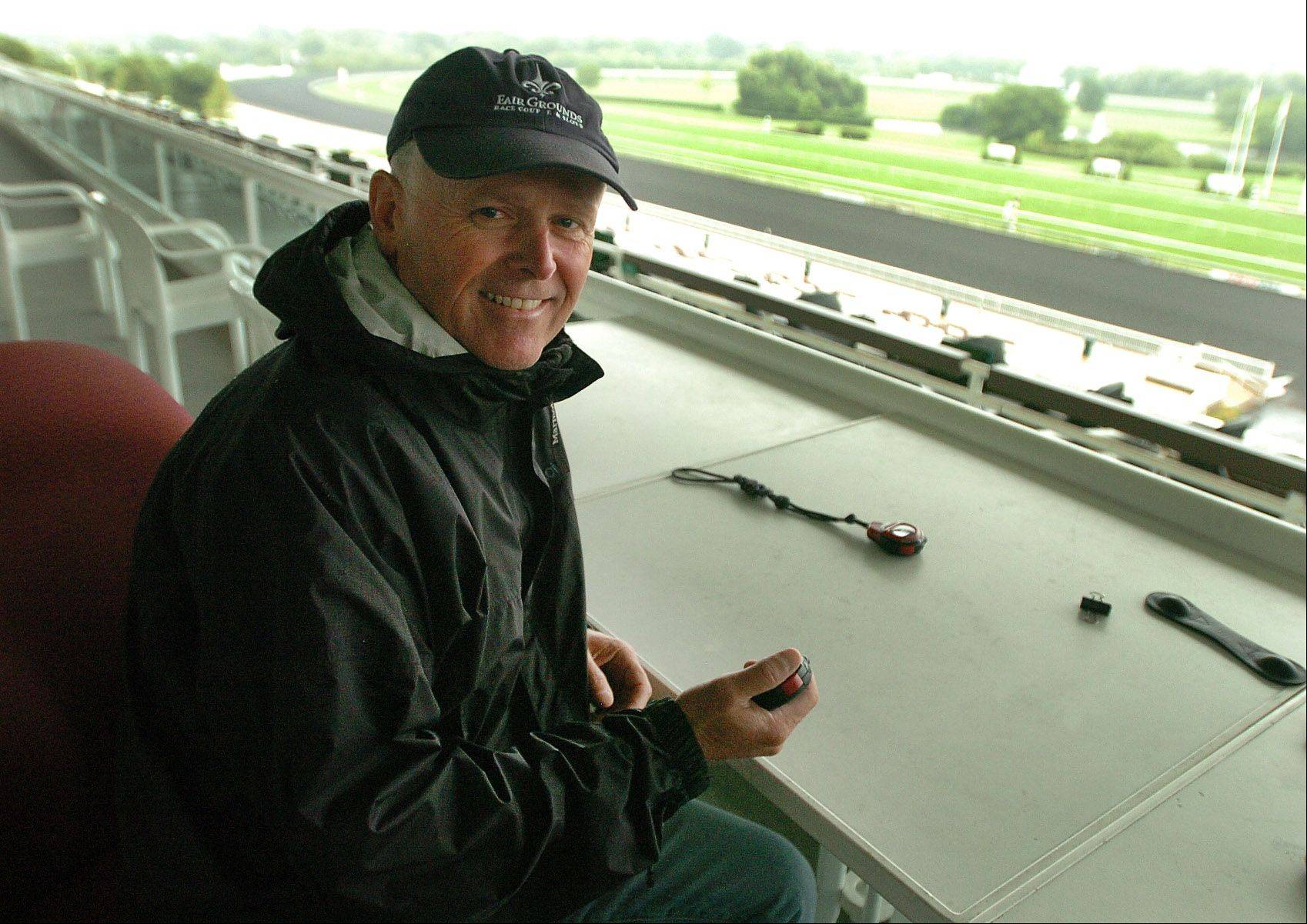 Mike Stidham, trainer of Willcox Inn, watches his horse work out on the track first thing Thursday morning in preparation for the Arlington Million.