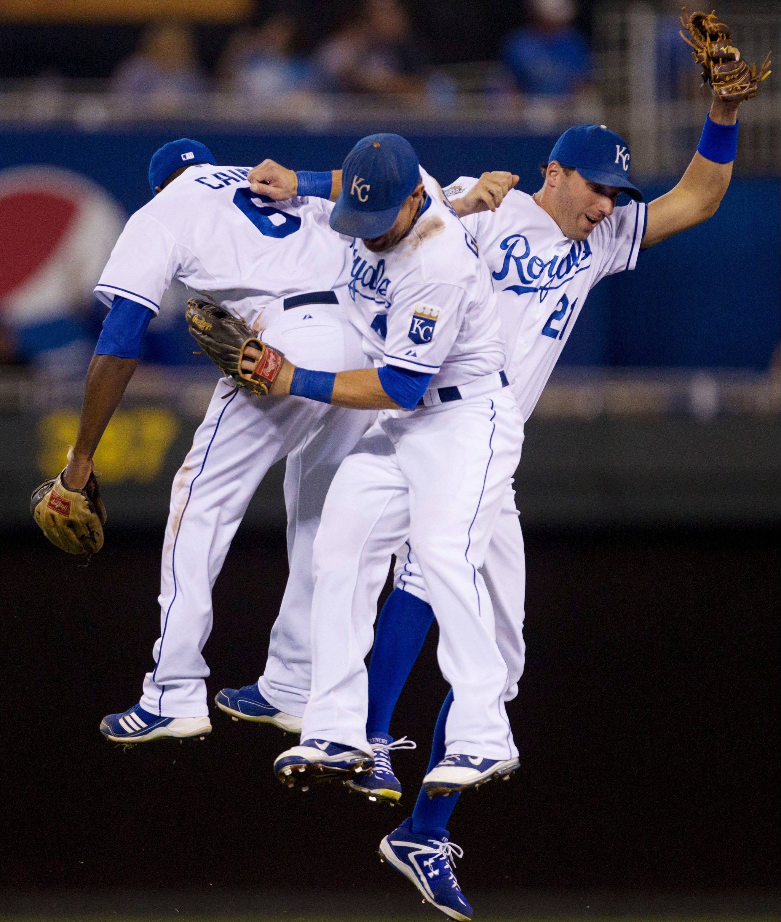 Kansas City Royals outfielders Alex Gordon (4), Lorenzo Cain (6) and Jeff Francoeur (21) celebrate Friday after beating the White Sox at Kauffman Stadium.