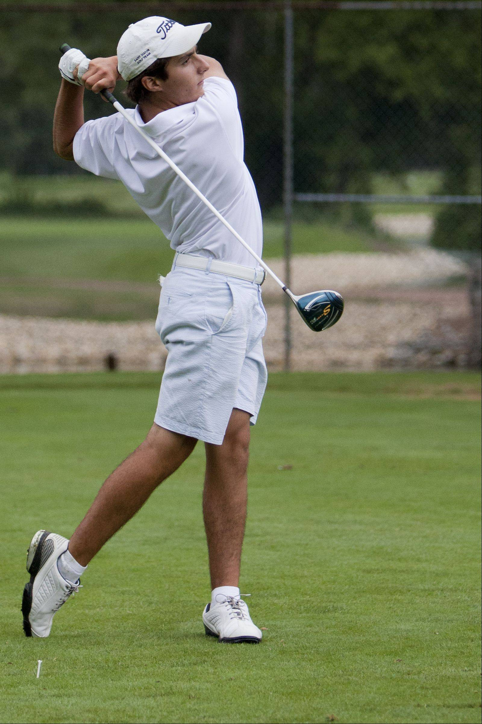 St. Viator junior Robert Renner tees off at Old Orchard Country Club in Mount Prospect during a practice session.