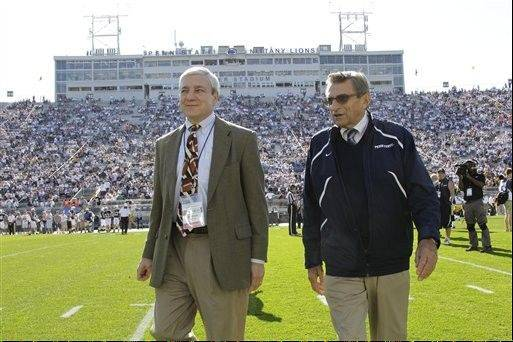 FILE - This Oct. 8, 2011 file photo shows Penn State president Graham Spanier, left, and head football coach Joe Paterno before a college football game against Iowa in State College, Pa. Attorneys for Penn State's ousted president are planning a news conference to rebut what they view as inaccuracies in a school-sanctioned report that concluded he concealed child sex-abuse allegations. Graham Spanier's lawyer tells The Associated Press that the legal team will meet with reporters in Philadelphia early next week. Peter Vaira says there are many errors in the report by former FBI Director Louis Freeh.