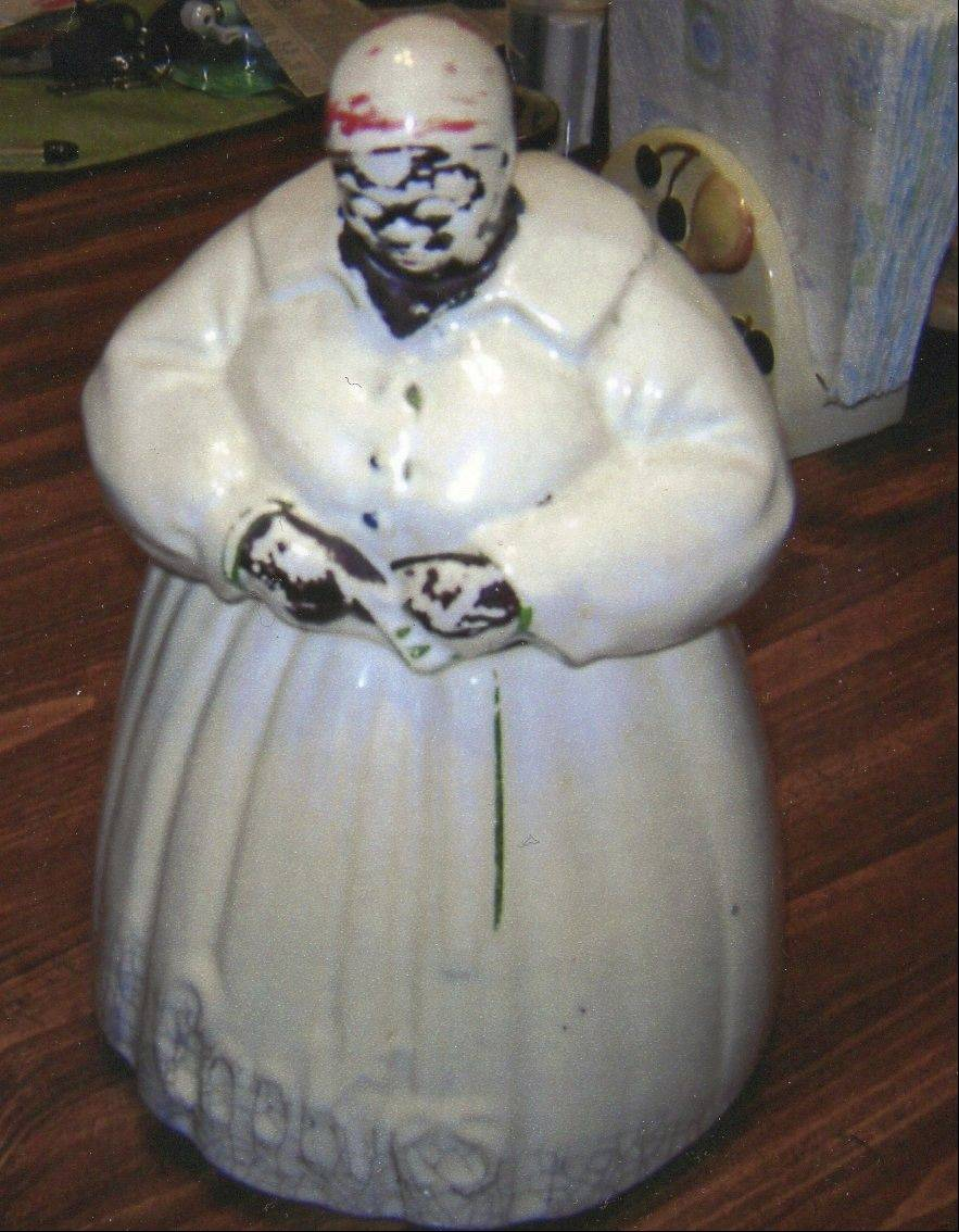 In its day, this cookie jar held yummy treats. But much of the paint is worn off now, and might not even sell if offered.