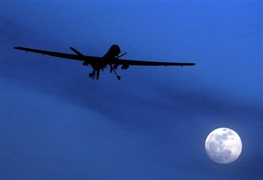 An unmanned U.S. Predator drone flies over Kandahar Air Field, southern Afghanistan, on a moon-lit night. A missile launched from a U.S. drone struck a suspected militant hideout in a tribal region in northern Pakistan where allies of a powerful warlord were gathered Saturday, Aug. 18, killing five of his supporters, Pakistani officials said.