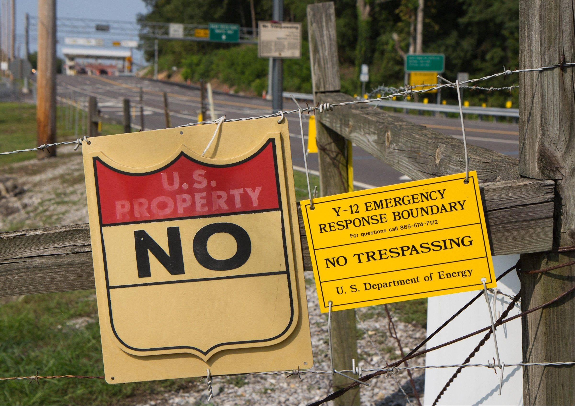 Signs warn against trespassing onto the Y-12 National Security Complex in Oak Ridge, Tenn.