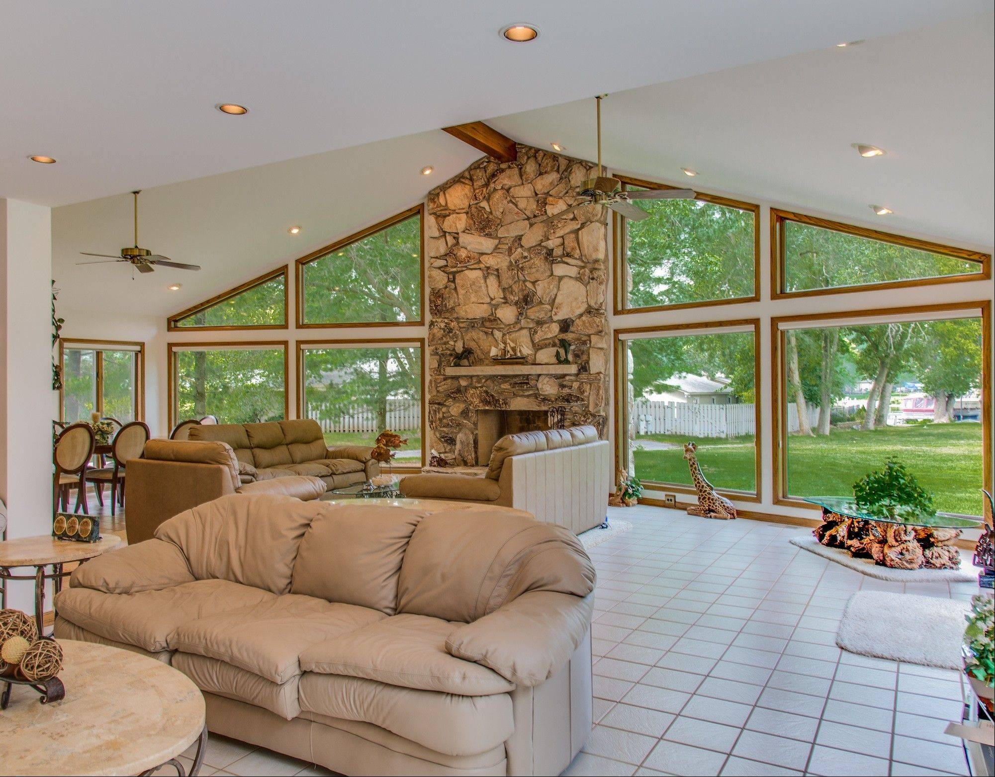 The great room with stone fireplace is both a summer and winter retreat.