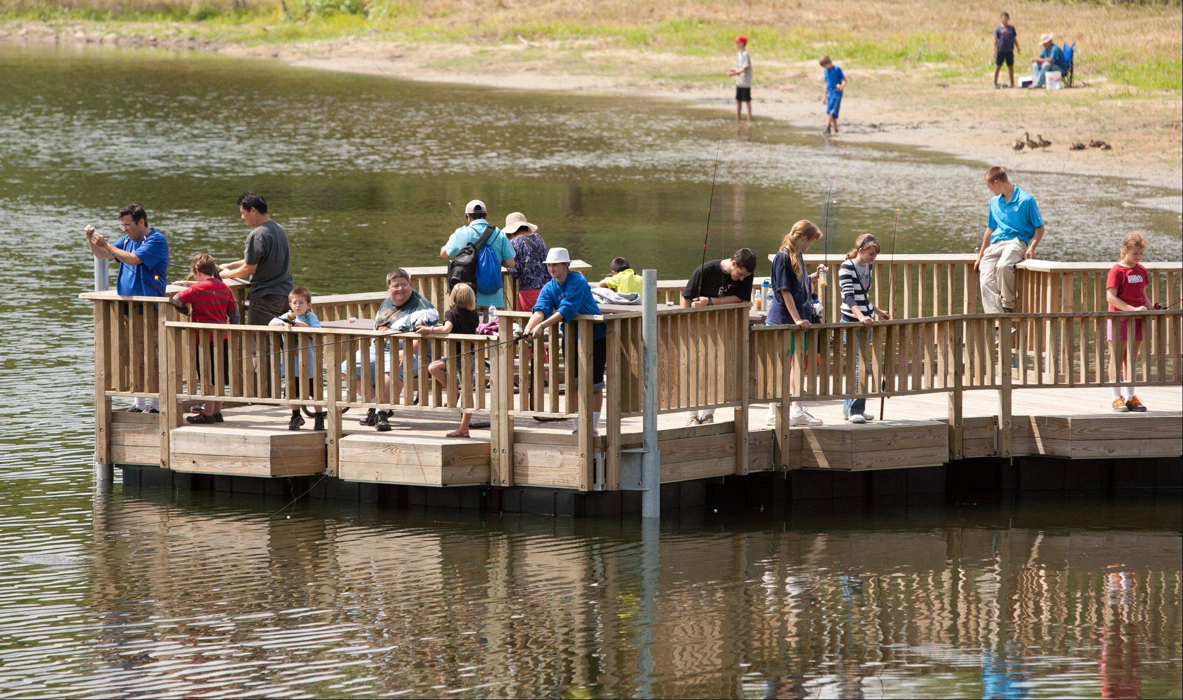 Daniel White/dwhite@dailyherald.comThe DuPage County Forest Preserve opens a handicapped-accessible fishing pier at the Blackwell Forest Preserve.