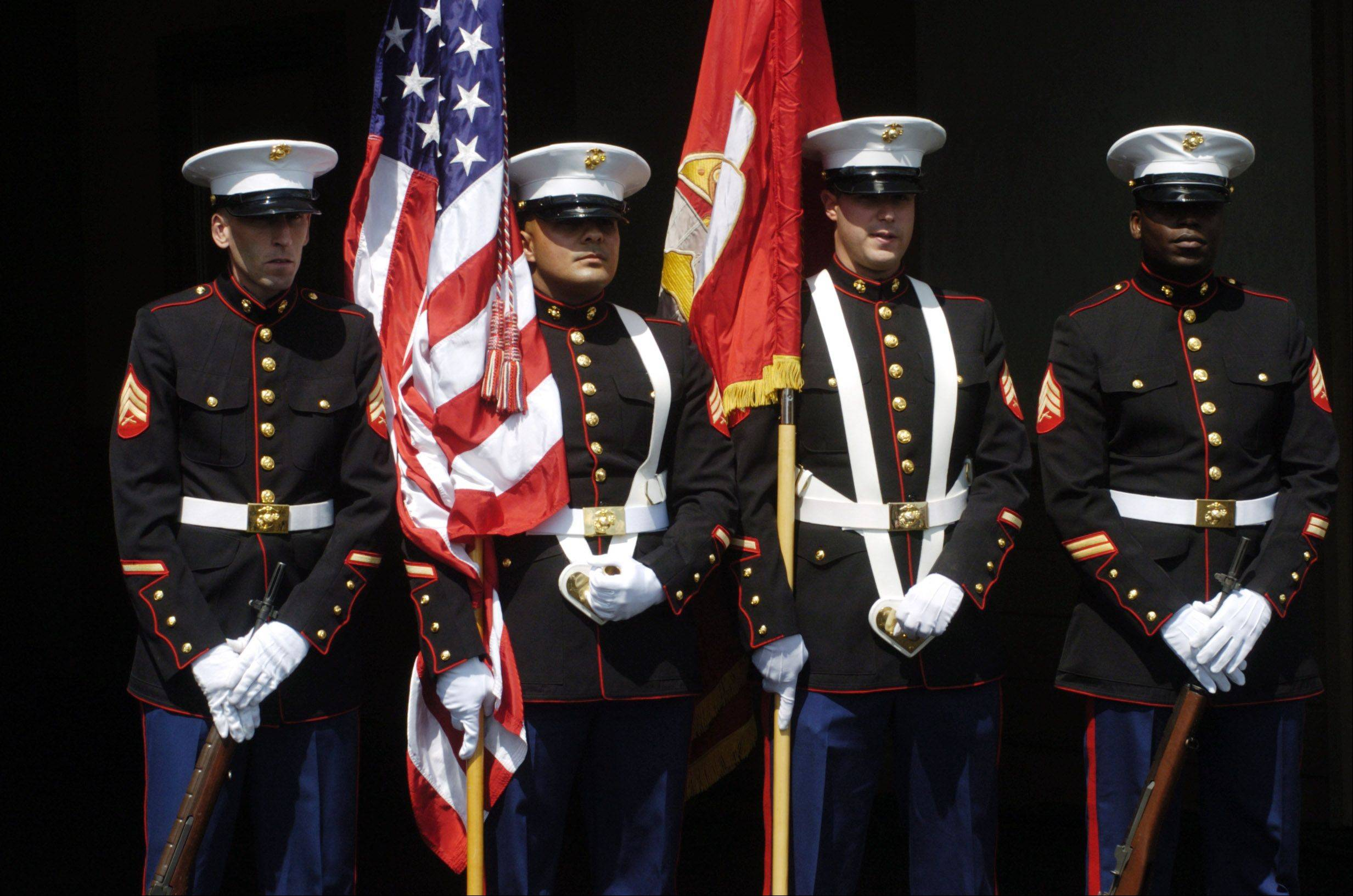 JOE LEWNARD/jlewnard@dailyherald.comThe Marine Color Guard is ready to present the colors prior to the singing of the National Anthem the Arlington Million at Arlington Park Saturday.