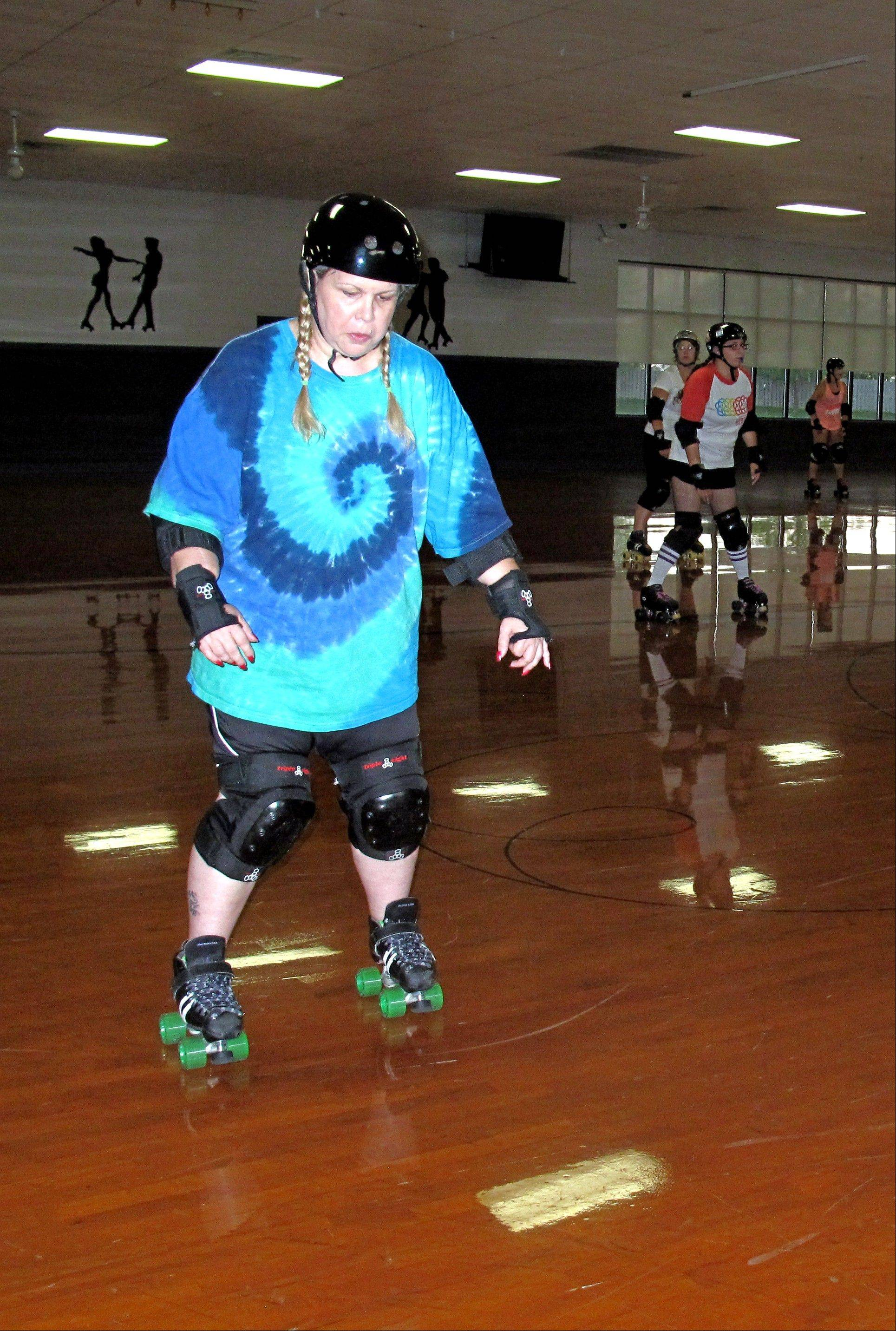 Sharon Caruso of Palatine practices skating backward at a recent Derby Lite exercise class in Lombard. Caruso said she enjoys the weekly classes as a fun way to relieve stress.