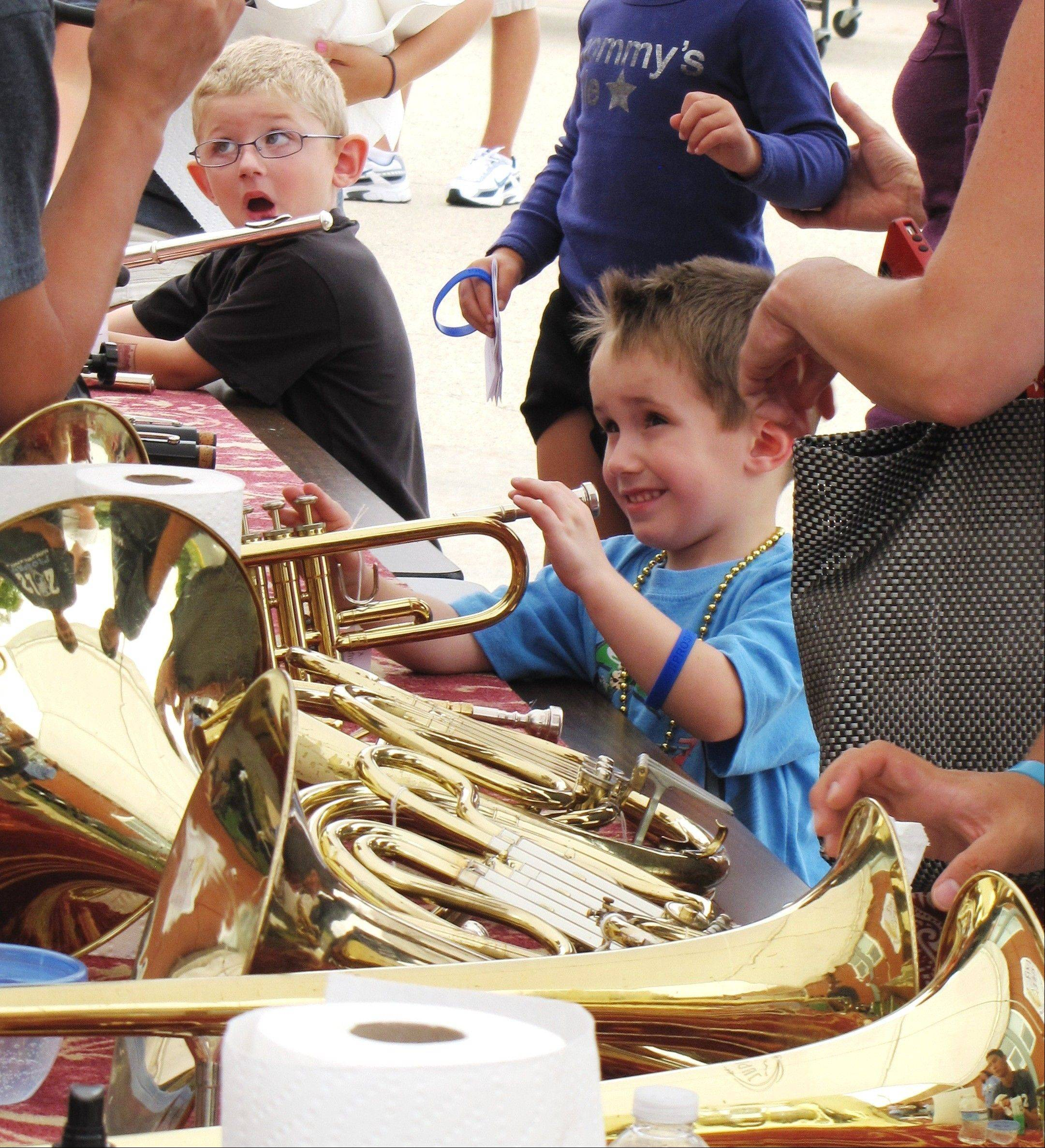 Sam Buttitta, 4, left, and Connor Michael, 3, both of Arlington Heights, test their budding musical talents.