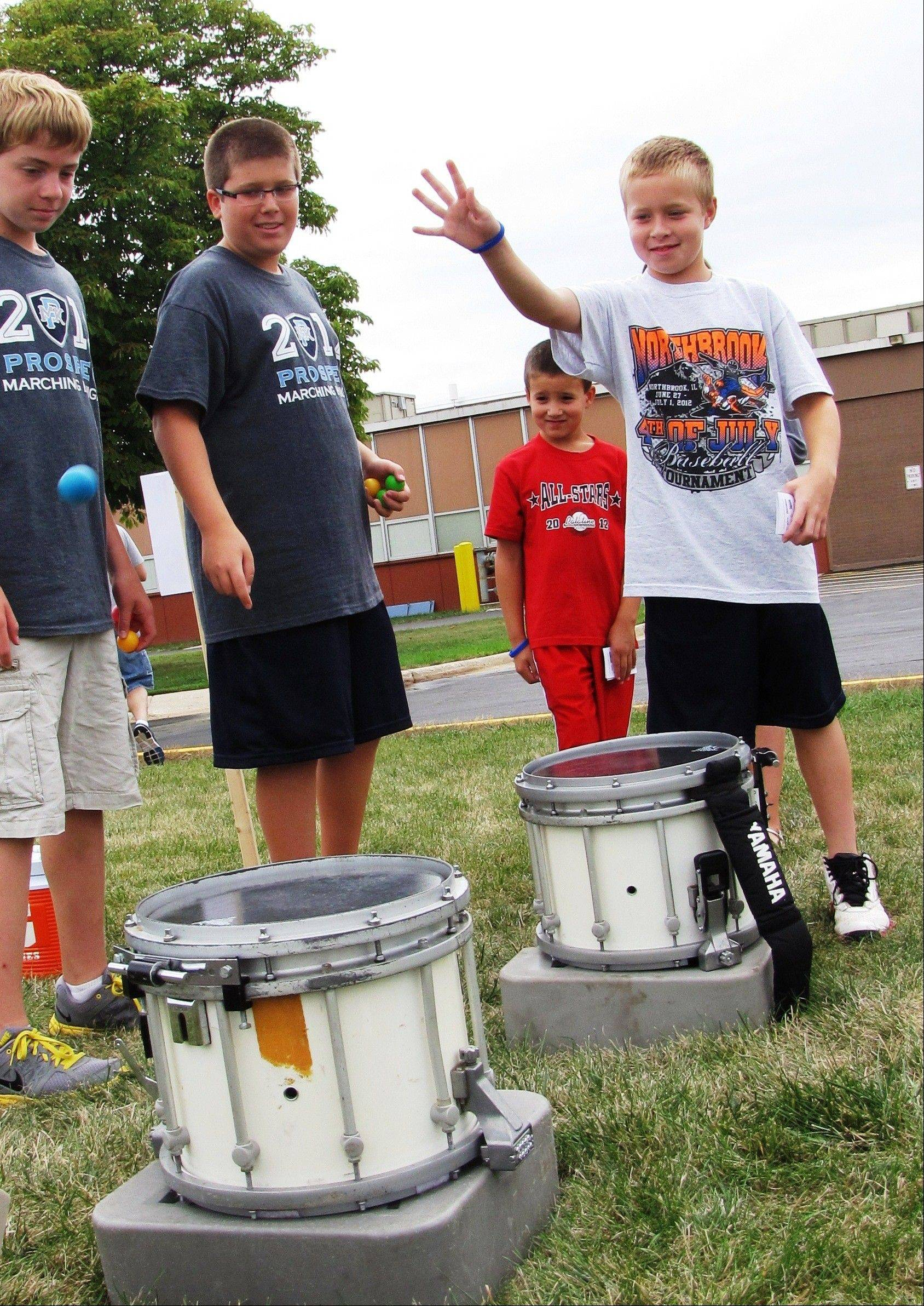 Mark, 8, and Matt, 10, Haddad (throwing) of Arlington Heights compete with each other on the Snare Skip, one of 30 games offered at the Day as a Knight fun fair.