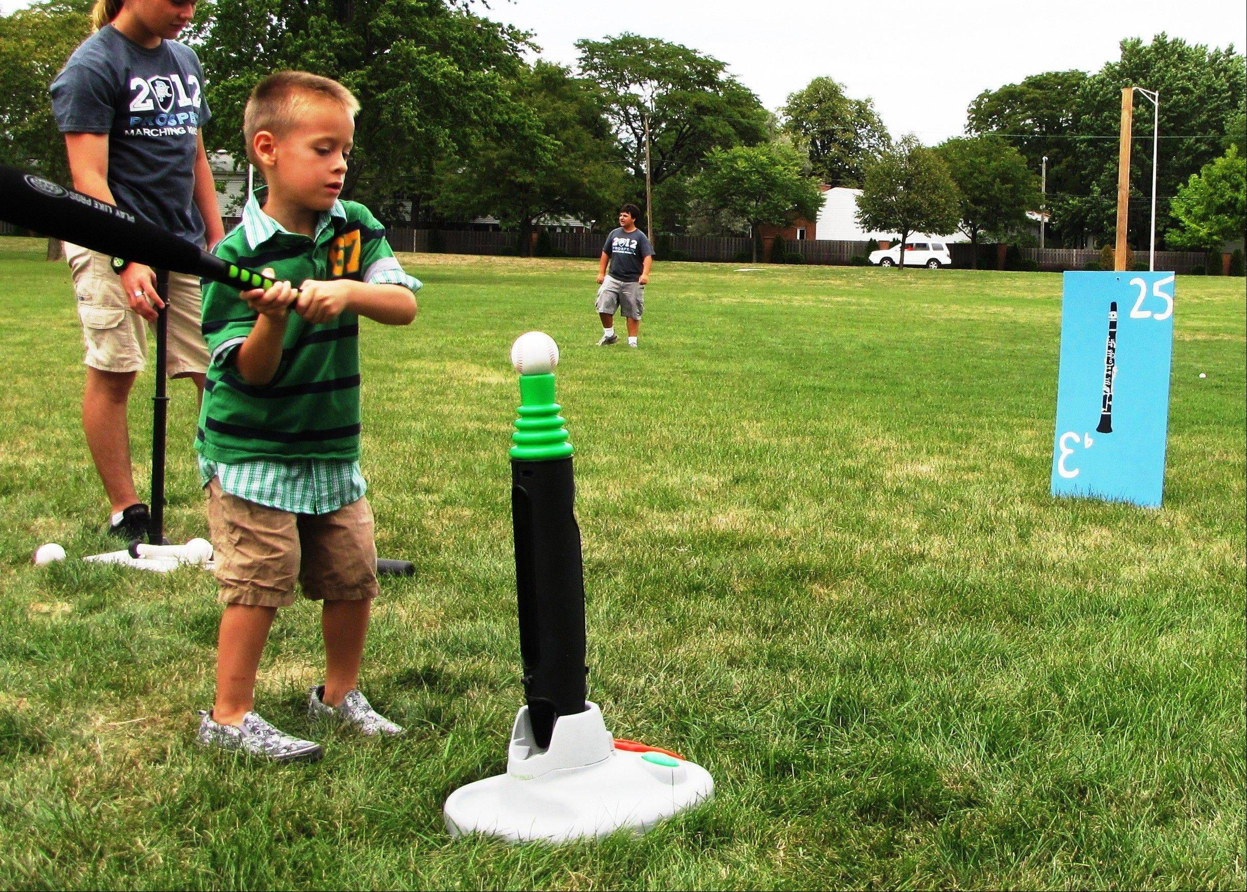 Landon Salgado, 5, of Palatine takes a swing at the Home Run Derby game.
