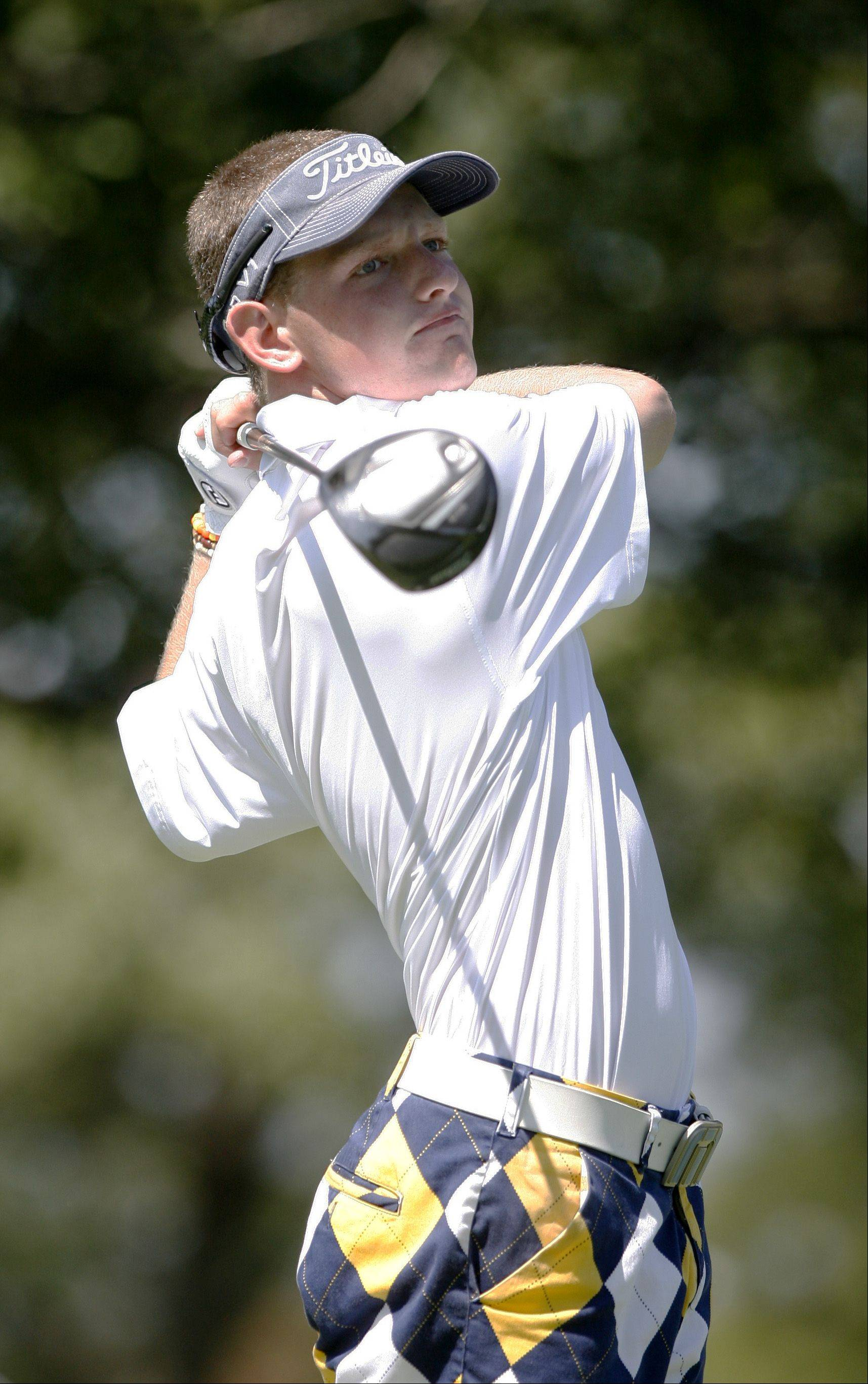 Daniel White/dwhite@dailyherald.comNeuqua Valley's Nick Rouches tees off during the Vern McGonagle Memorial High School Golf Championship, held at the Naperville Country Club.