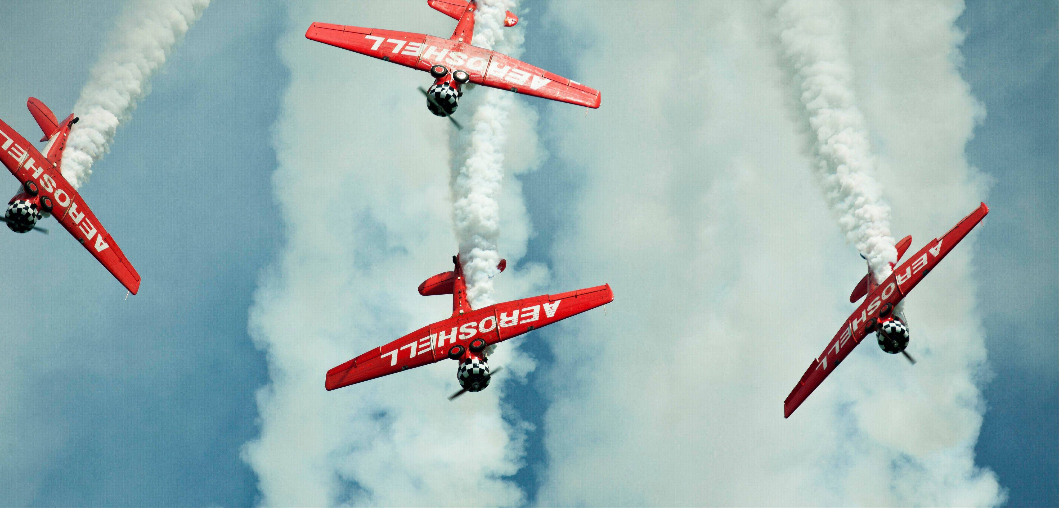 The Aeroshell Aerobatic Team performs on the opening day of the Chicago Air and Water Show on Saturday, Aug. 18, 2012 in Chicago.