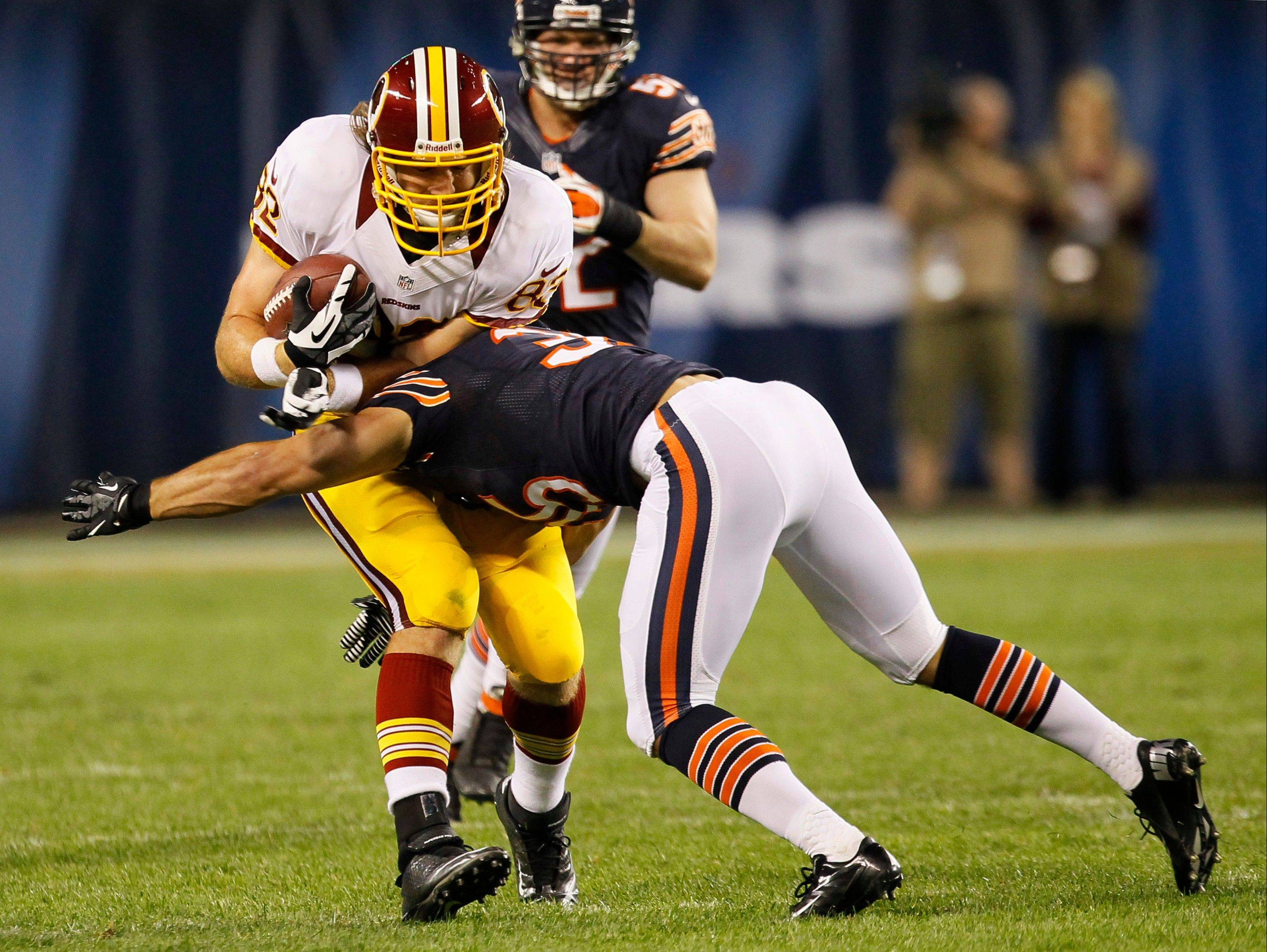 Brandon Hardin tackles Redskins tight end Logan Paulsen during the second half of the Bears' preseason win Saturday at Soldier Field. Hardin, the team's third-round draft pick, was taken off the field on a stretcher after the play.