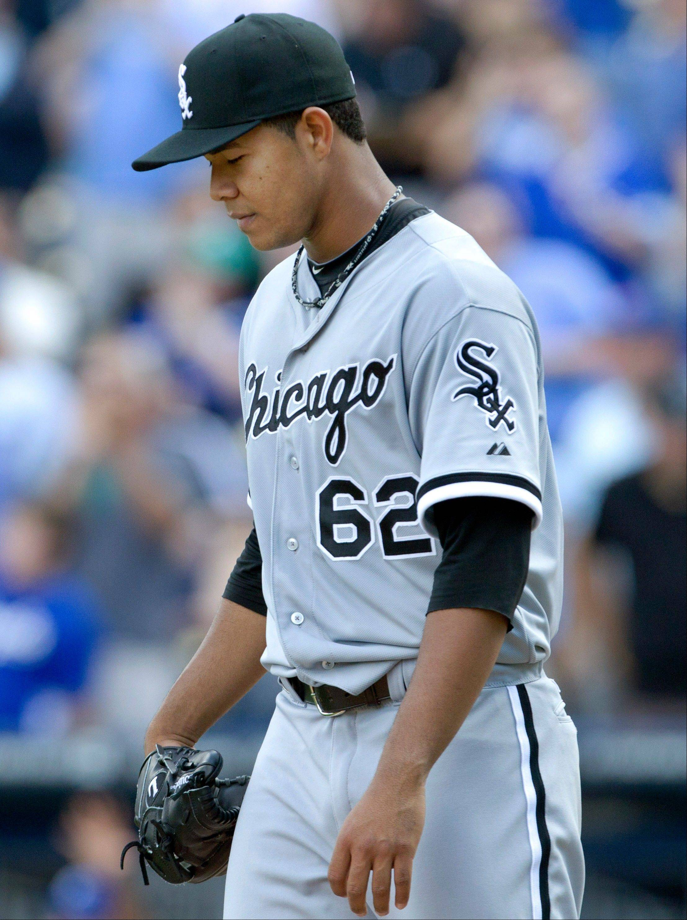 White Sox starting pitcher Jose Quintana walks to the mound Sunday after giving up a two-run double in sixth inning in Kansas City.