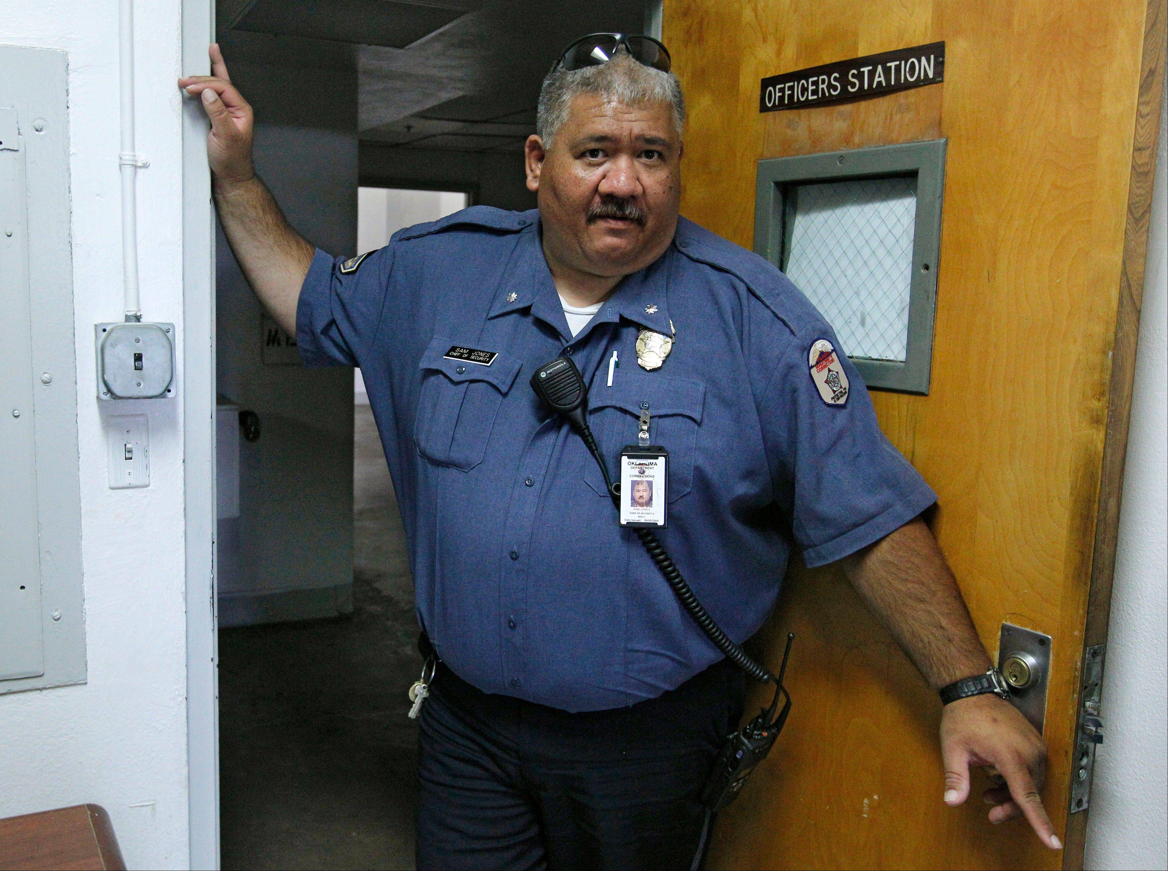 Sam Jones, chief of security at the William S. Key Correctional Center, is pictured during an interview at an officer's workstation in Ft. Supply, Okla. Jones said he's lost two officers to jobs in the energy industry in just the past few months, including a 10-year veteran who worked as a supervisory sergeant.