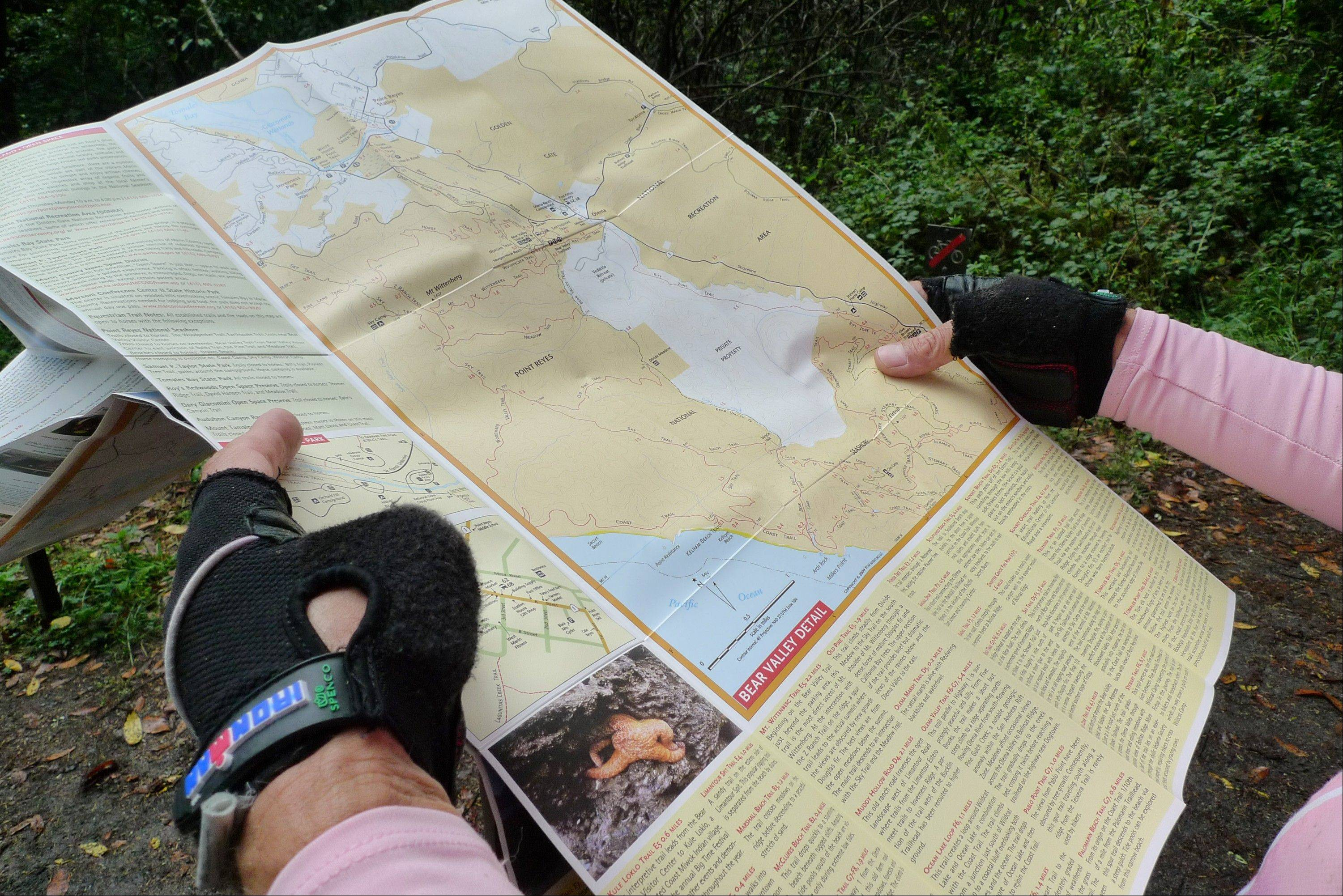 Timothy McCarthy, of Berkeley, Calif., consults a trail map at Point Reyes National Seashore in Marin County, Calif. This part of the tour included a hiking and mountain bike jaunt along some of the park's many trails.