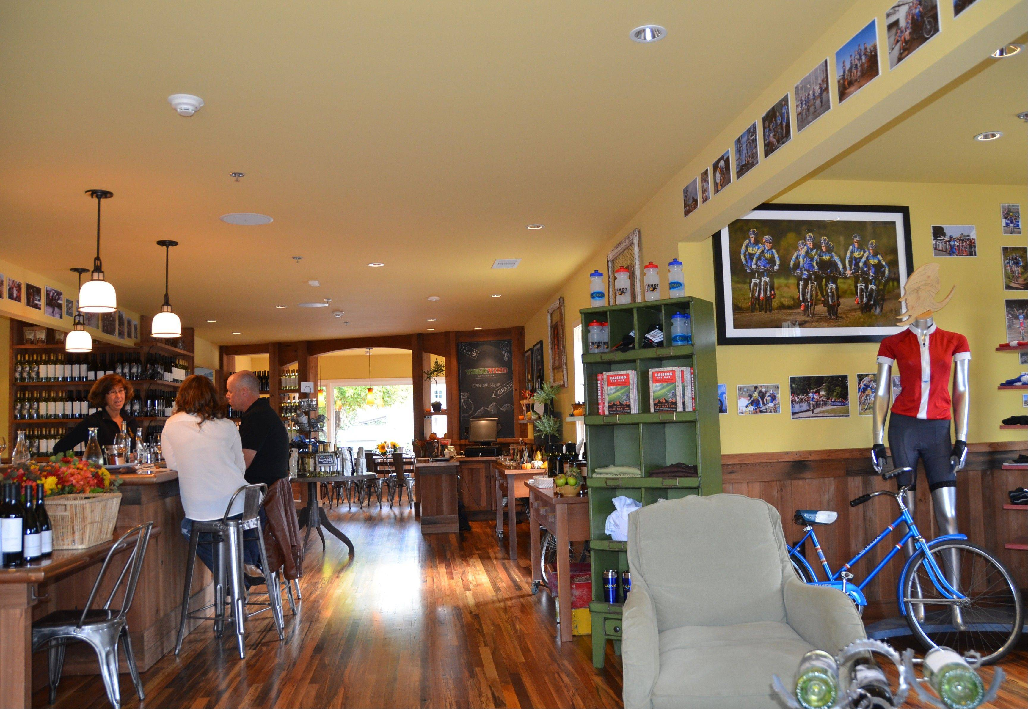 Visitors sample both wine and cycling memorabilia during a stop at Velo Vino Napa Valley in St. Helena, Calif., founded by the family that makes Clif Bars and Clif Family wines.
