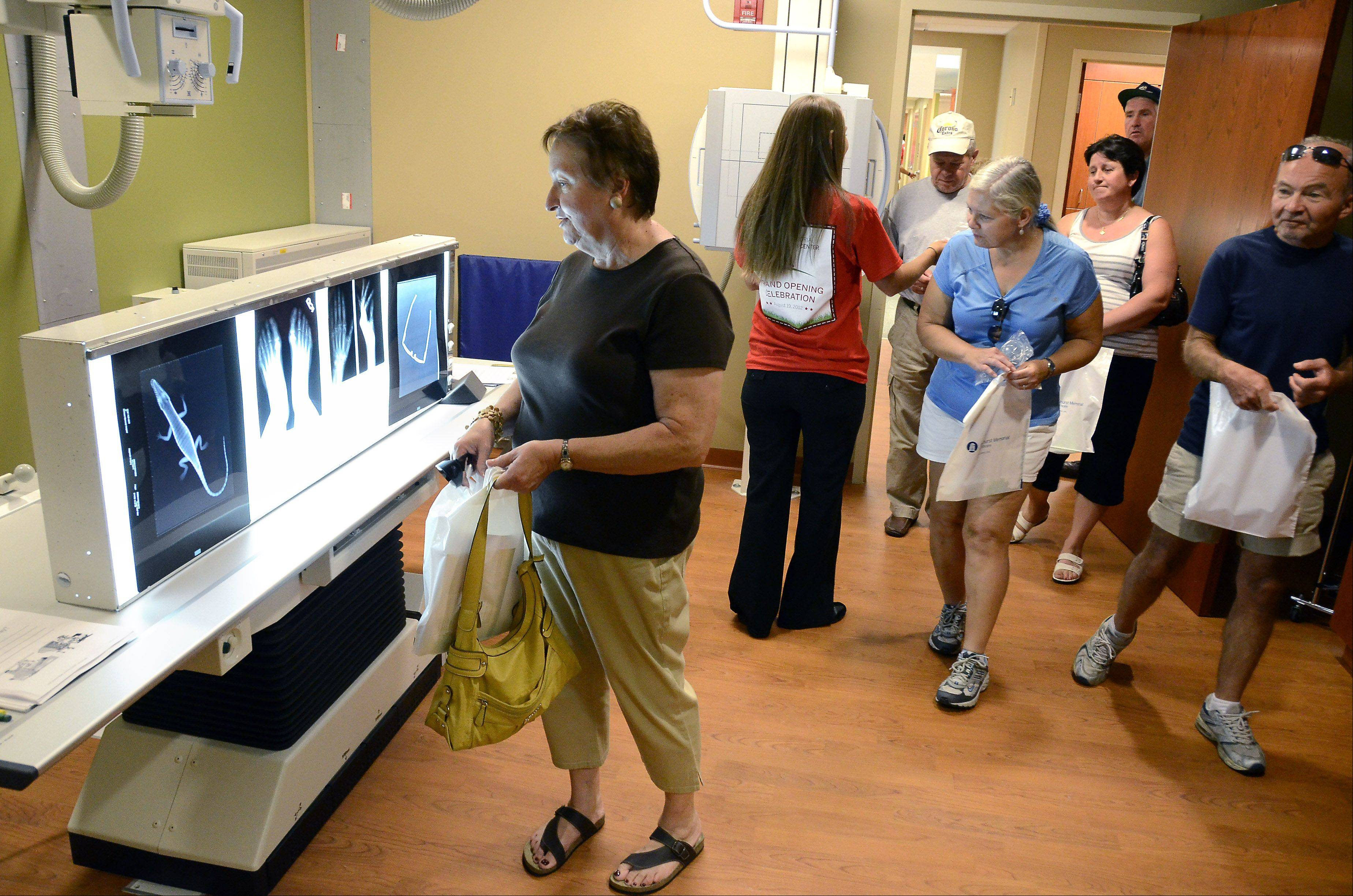 Guests tour the X-ray lab at the opening of the Elmhurst Memorial Hospital Addison Health Center Sunday in Addison.