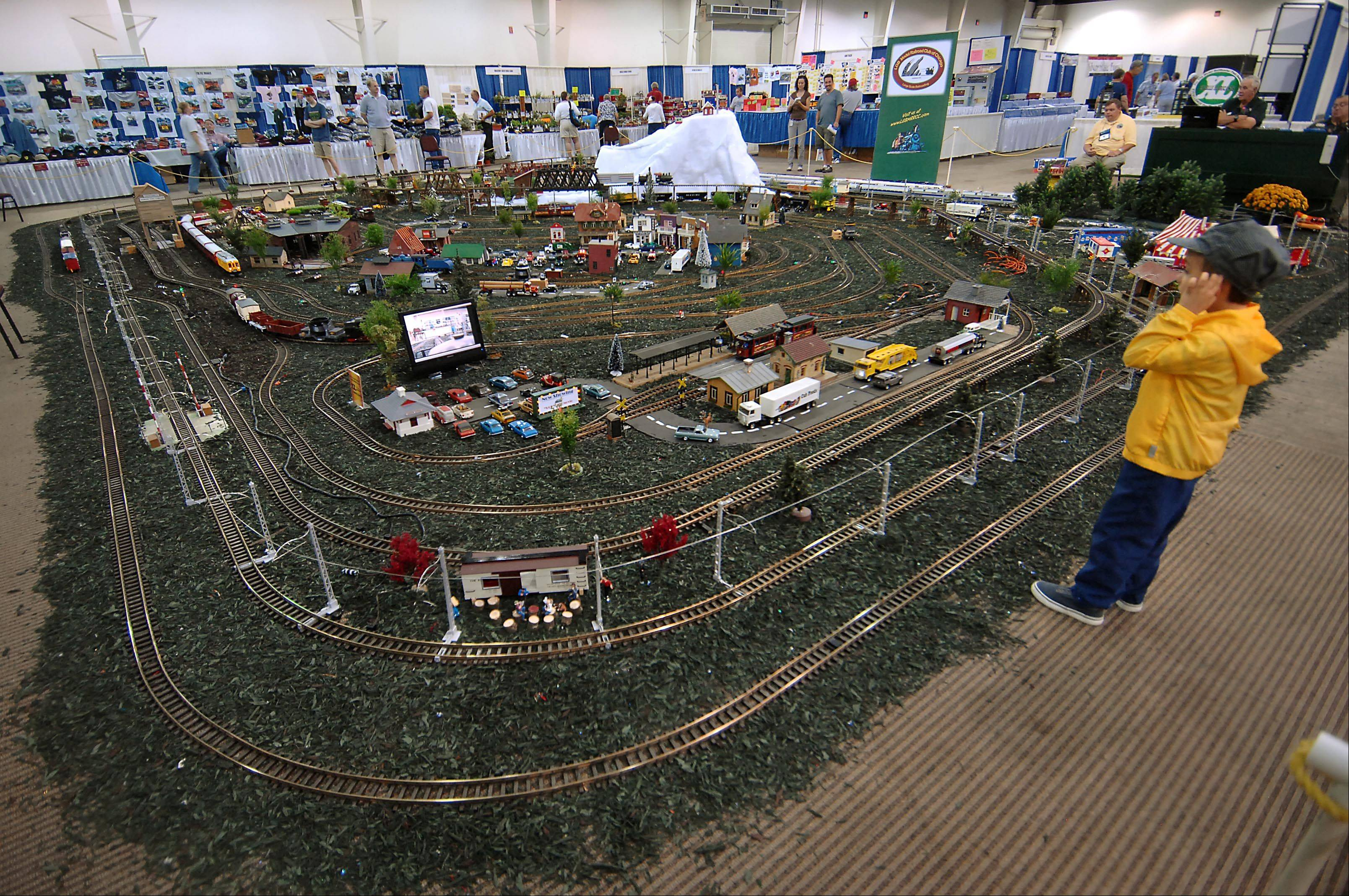 David Jovic, 5, stares at a huge model train layout while wearing his conductor's hat Sunday at the 28th National Garden Railway Convention in St. Charles. He was with his dad Ray, of Lake Zurich.