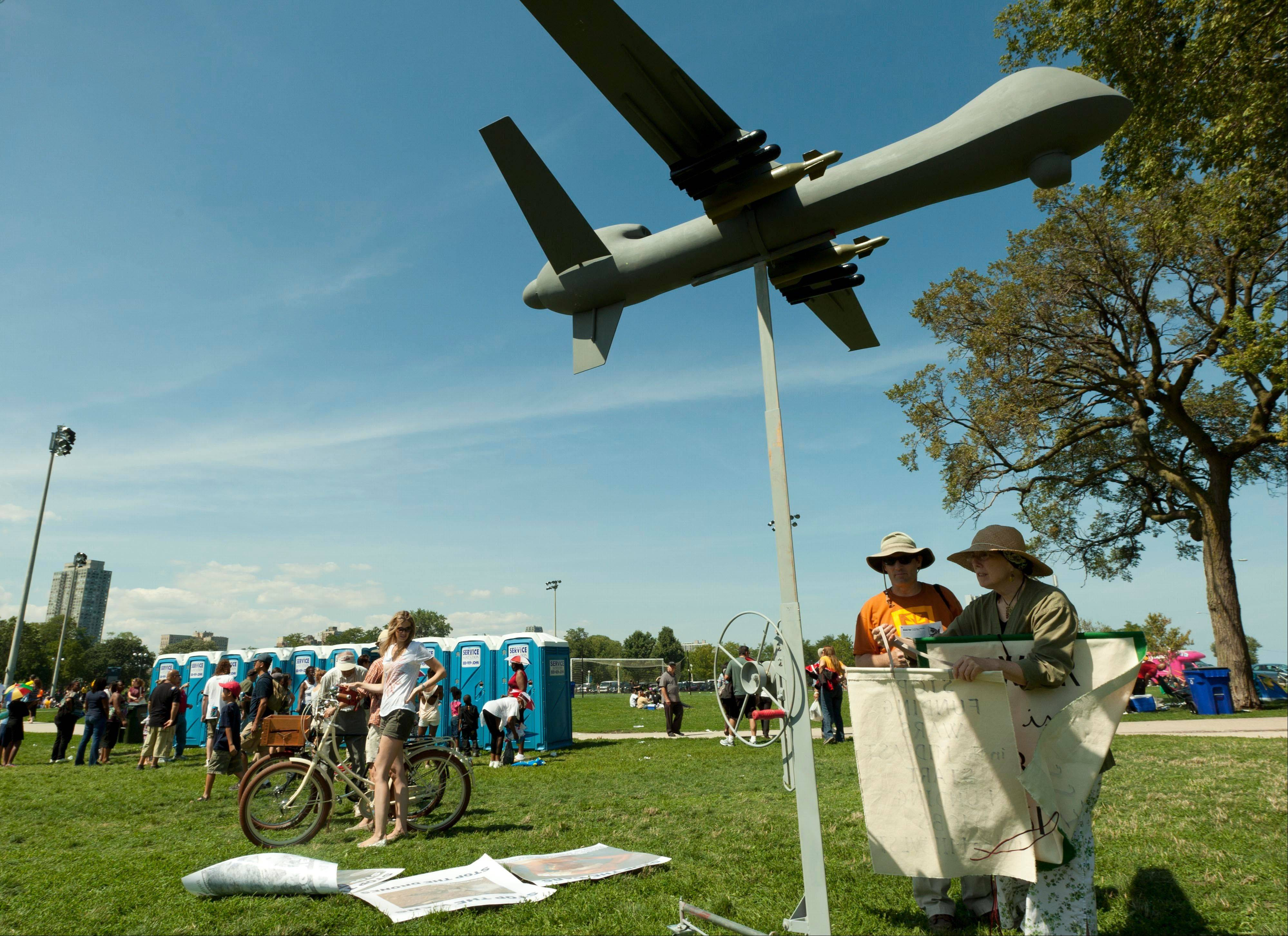 Opponents to the U.S. military's use of drones in warfare set up a drone replica display to present their case to people attending the Chicago Air and Water Show on Saturday, Aug. 18, 2012 in Chicago. They say that one in four people killed by drones have been children.