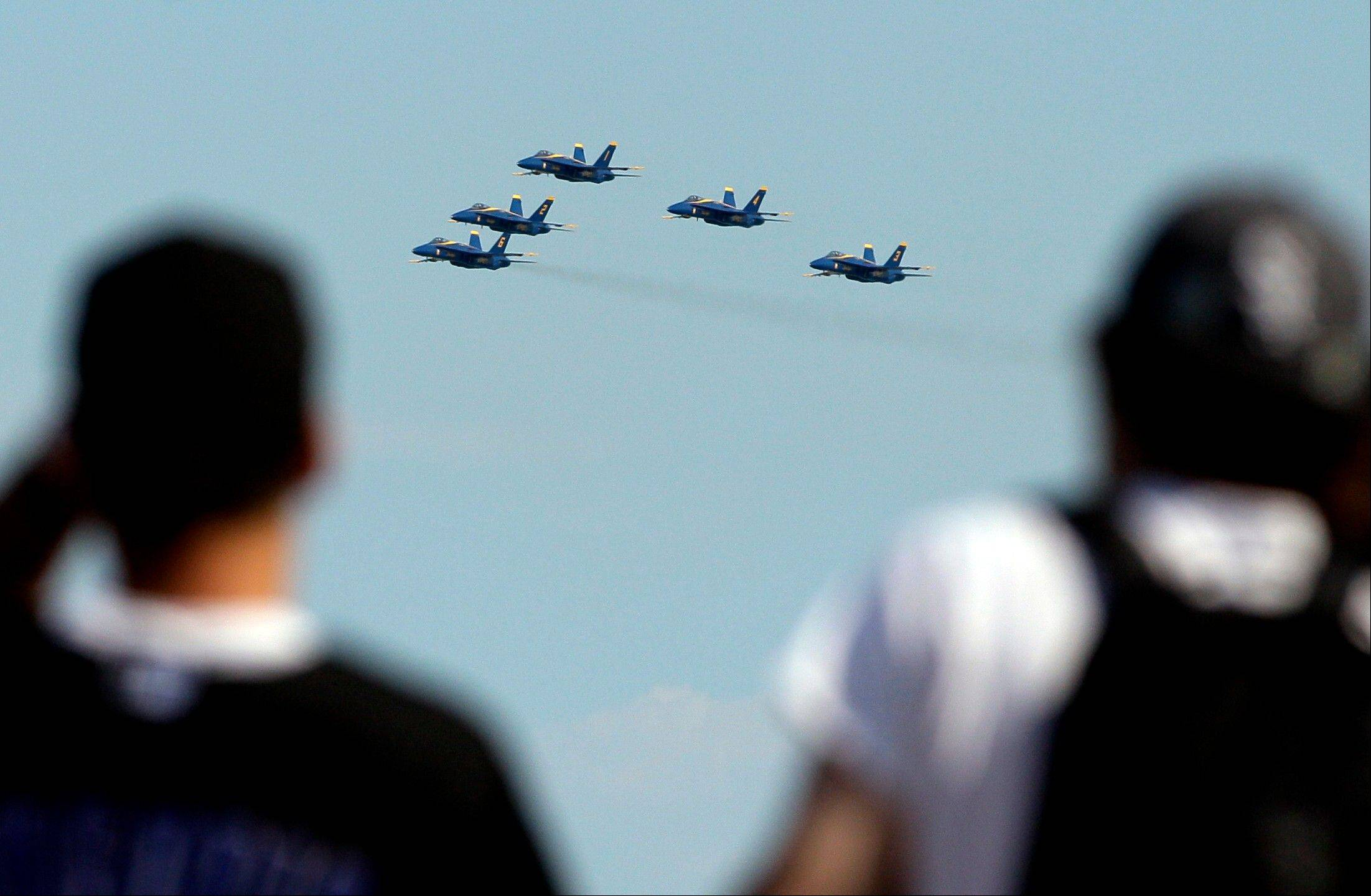 The U.S. Navy Blue Angels perform over Lake Michigan during the Chicago Air and Water Show on Sunday, Aug. 19, 2012, in Chicago.