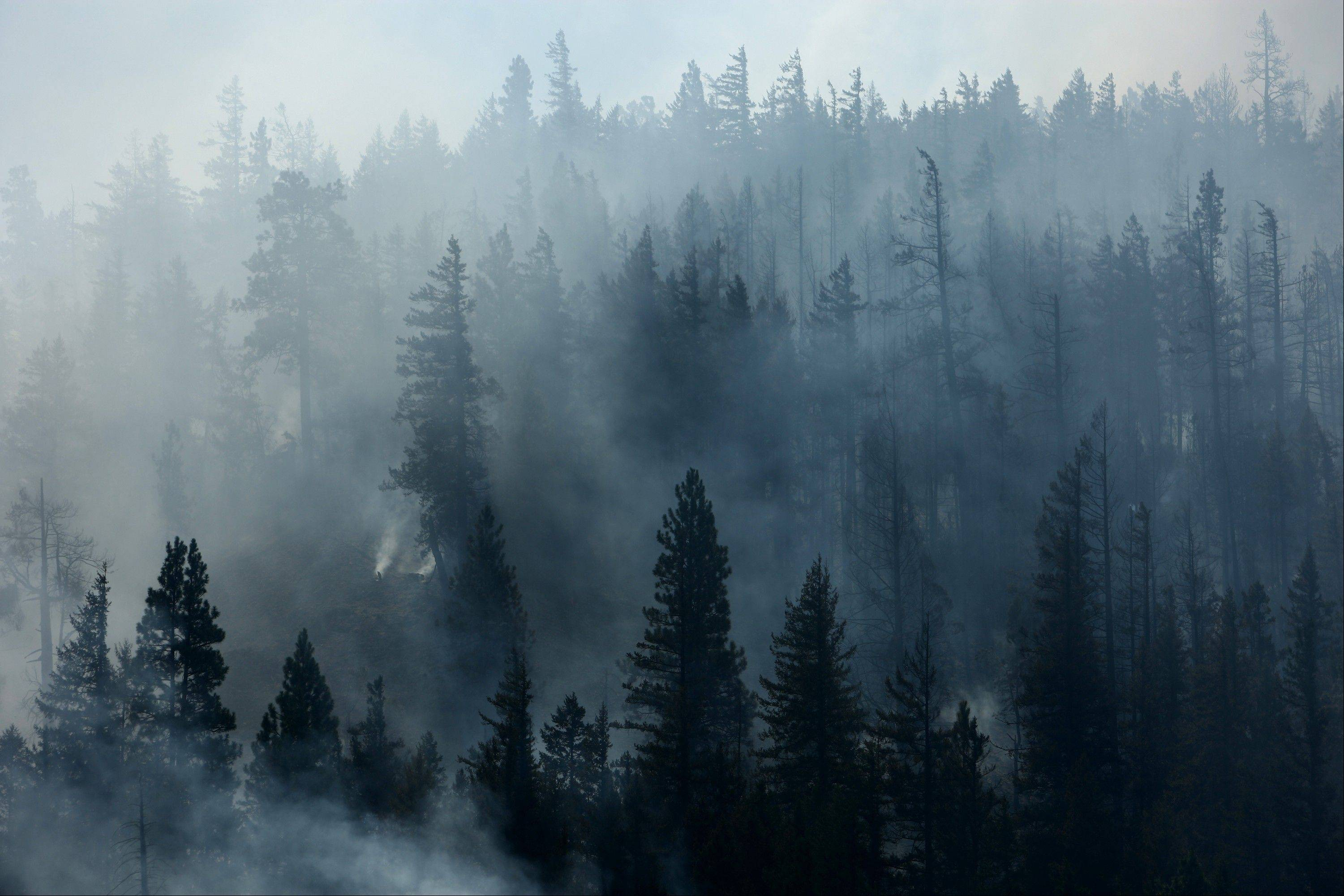 Fire burns above Hidden Valley Ranch where fire crews worked to halt progression of the Taylor Brige Fire on Thursday, August 16, 2012, near Cle Elum, Wash. The Taylor Bridge Fire has forced hundreds to evacuate and has burned dozens of homes near Cle Elum, Wash.