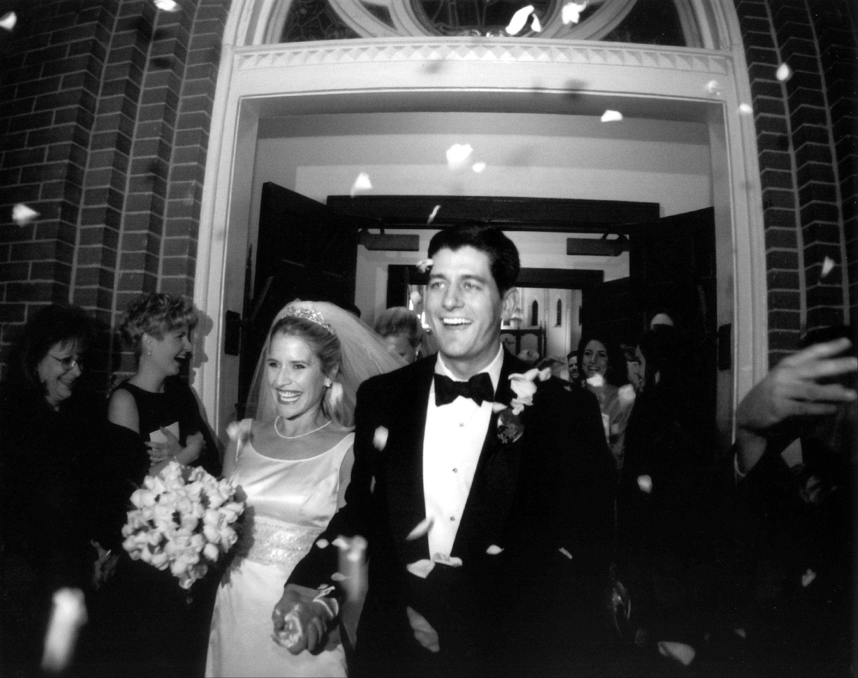 This undated photo provided by the Ryan family shows Paul Ryan and Janna Ryan on the day of their wedding. During his first term in Congress, Ryan met and married Janna Little, a lawyer and lobbyist from an affluent Oklahoma family, who was working in the Washington area. In the days since Republican presidential candidate, former Massachusetts Gov. Mitt Romney selected Ryan for the vice presidential slot on the Republican ticket, the now 42-year-old congressman's biography has become instant folklore. Lifelong resident of a little city in the heartland, embracing new responsibilities as a teen after the sudden death of his father. Devoted husband and father, devout Roman Catholic, avid deer hunter, fisherman and fitness buff.
