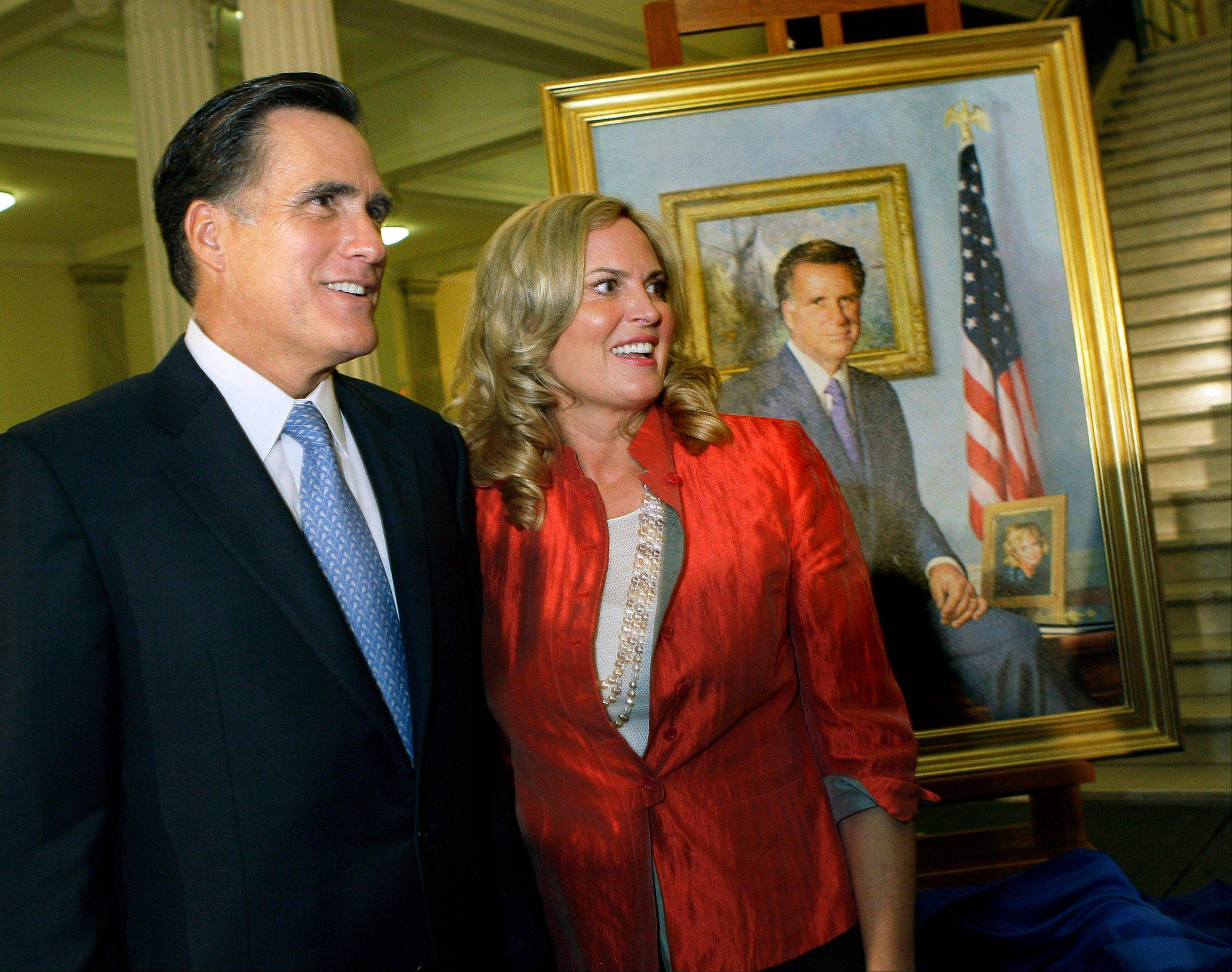 In this June 30, 2009, file photo, former Massachusetts Gov. Mitt Romney and his wife, Ann, greet guests after his official portrait is unveiled during a ceremony on the Grand Staircase at the Statehouse in Boston. Romney's portrait was painted by New Hampshire artist Richard Whitney for $30,000 in private donations and will hang in the lobby of the third-floor Governor's Office.
