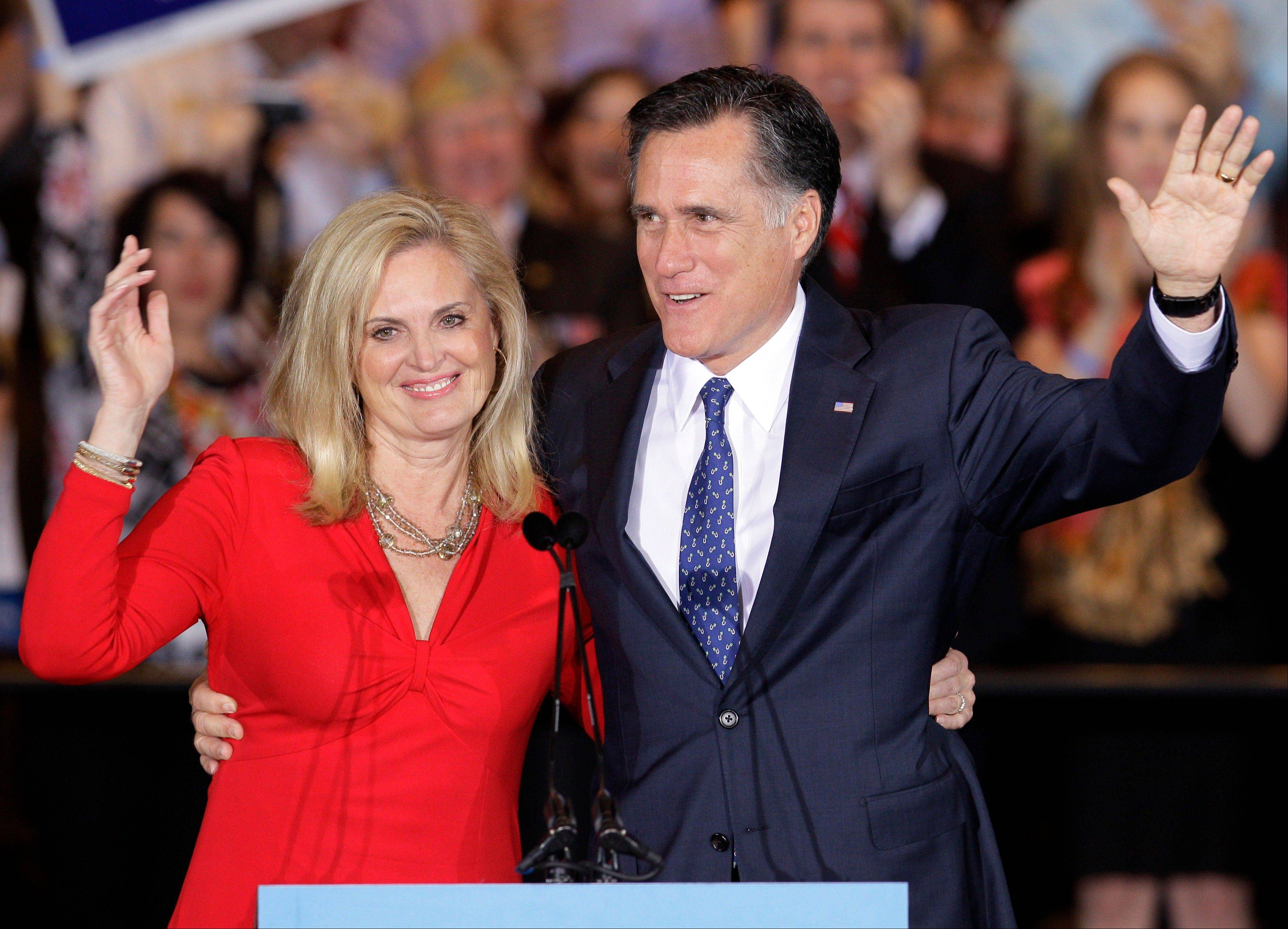 In this March 20, 2012, file photo, Republican presidential candidate, former Massachusetts Gov. Mitt Romney and his wife Ann wave as they leave at an election night rally in Schaumburg, Ill., after winning the Illinois Primary.