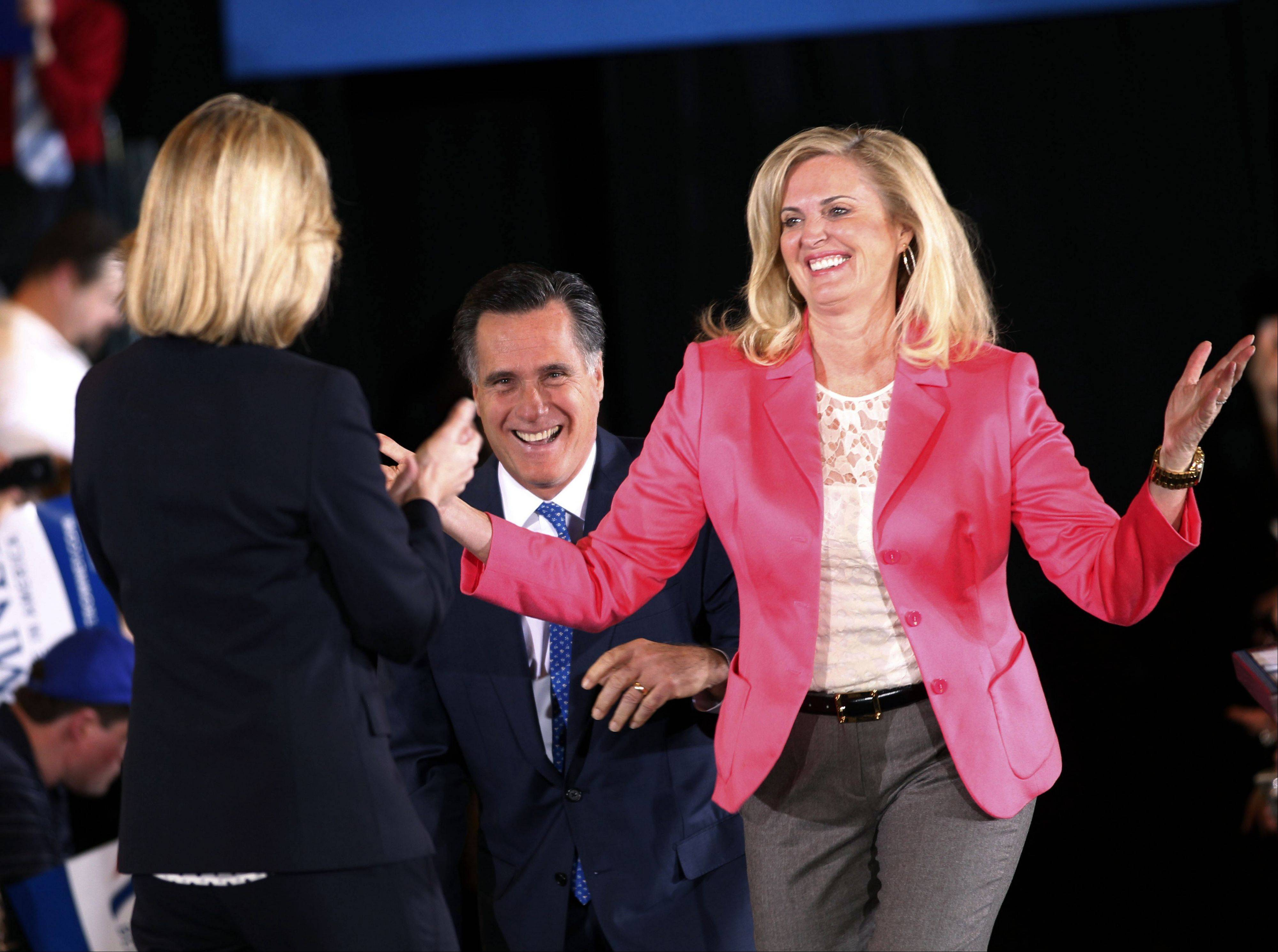 "In this March 6, 2012, file photo, Republican presidential candidate, former Massachusetts Gov. Mitt Romney, and his wife Ann arrive on stage as they are greeted by former Mass. Lt. Gov. Kerry Healey, at their Super Tuesday primary watch party in Boston. To the yearbook editors at the all-girl Kingswood School, Ann Lois Davies' destiny seemed pretty obvious. ""The first lady,"" the entry beside the stunning blond beauty's photo in the 1967 edition of ""Woodwinds"" concluded."