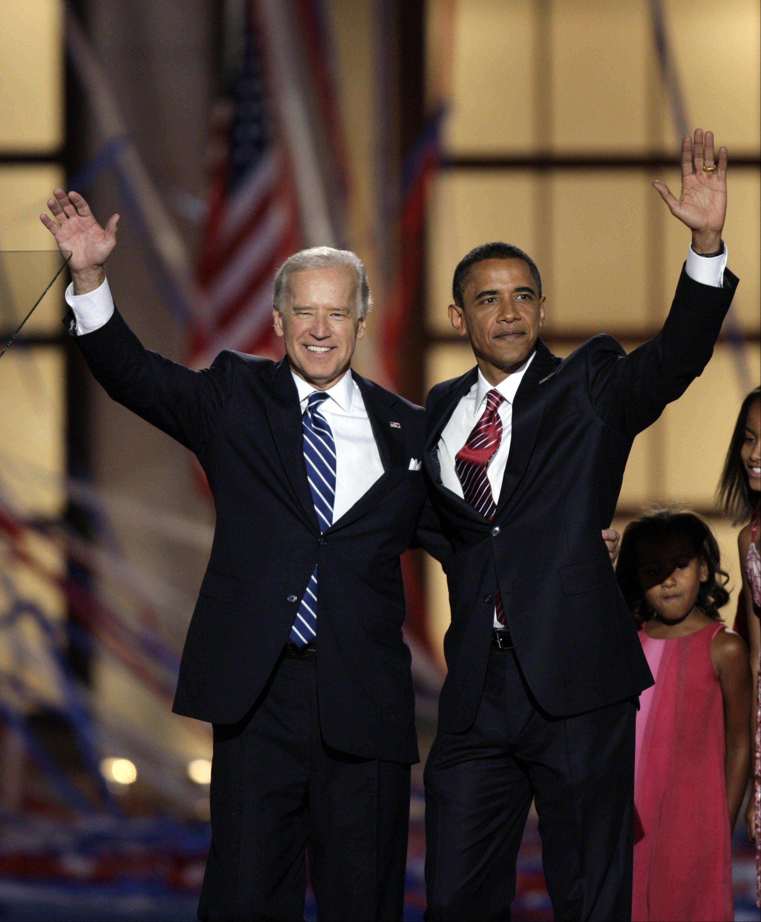 In this Aug. 28, 2008, file photo, Democratic presidential nominee, then-Sen. Barack Obama, D-Ill., and his running mate, then-Sen. Joe Biden, D-Del., wave after Obama's acceptance speech at the Democratic National Convention in Denver. Nearly four years after Barack Obama was elected to the most powerful office in the most powerful country in the world, the question remains: Who is he? This is a man who seemed to come out of nowhere. He had served seven years in the Illinois state Senate, and less than four years in the U.S. Senate _ a meager political resume, augmented by a stirring speech at the 2004 Democratic National Convention.