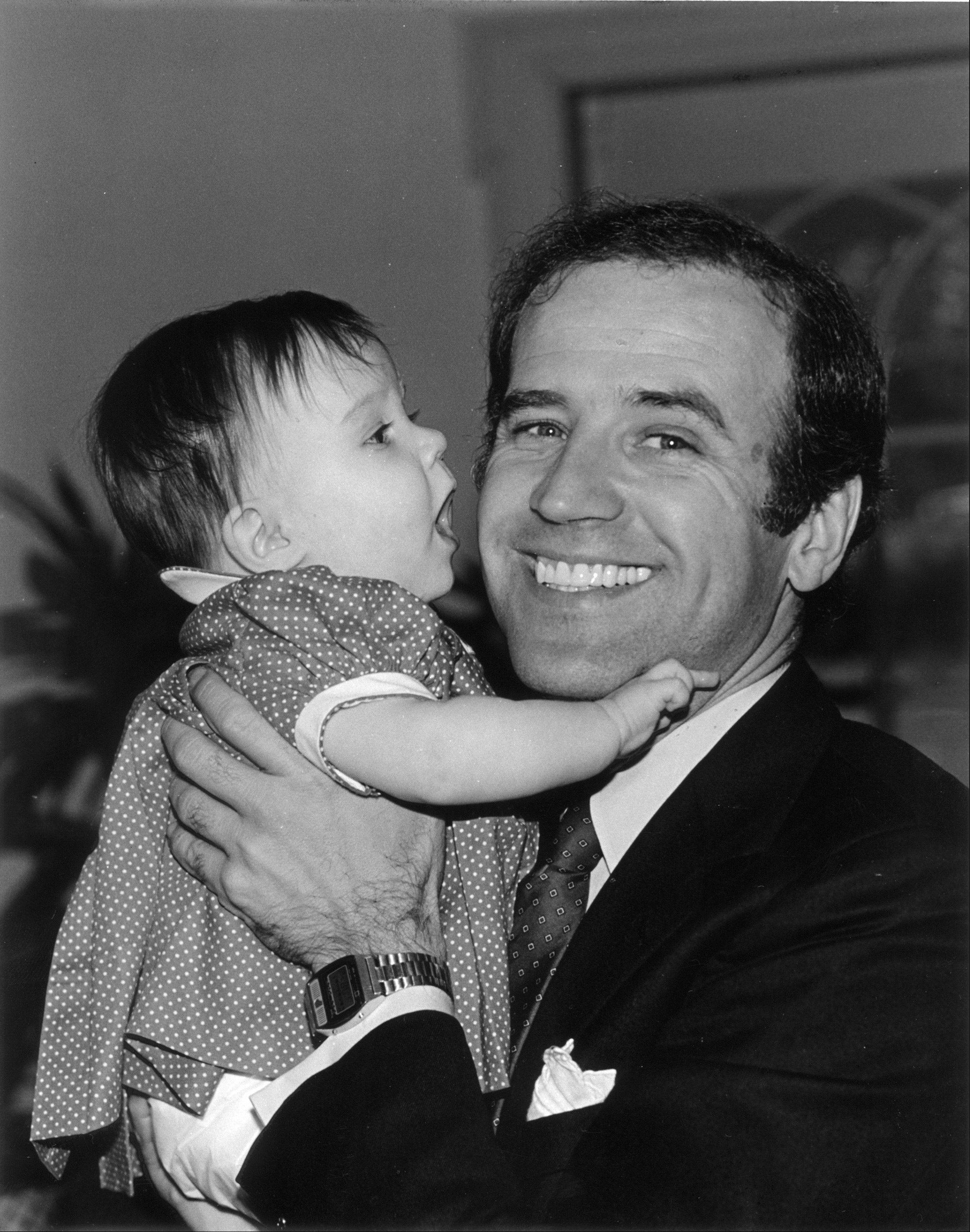 In this photo provided by Sen. Joe Biden's office, then-Sen. Joe Biden, D-Del., holds his daughter Ashley. In May, after Joe Biden tripped up his boss by voicing support for same-sex marriage while the president remained on the fence, there was speculation about whether the remarks were spontaneous or deliberate. But to those who know Biden, there was no doubt. He was just speaking his mind.