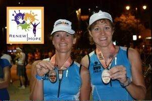 Diane Peterson, left, and Kristen David show off their medals upon completion of their first Ironman competition in Madison, Wis., last year.
