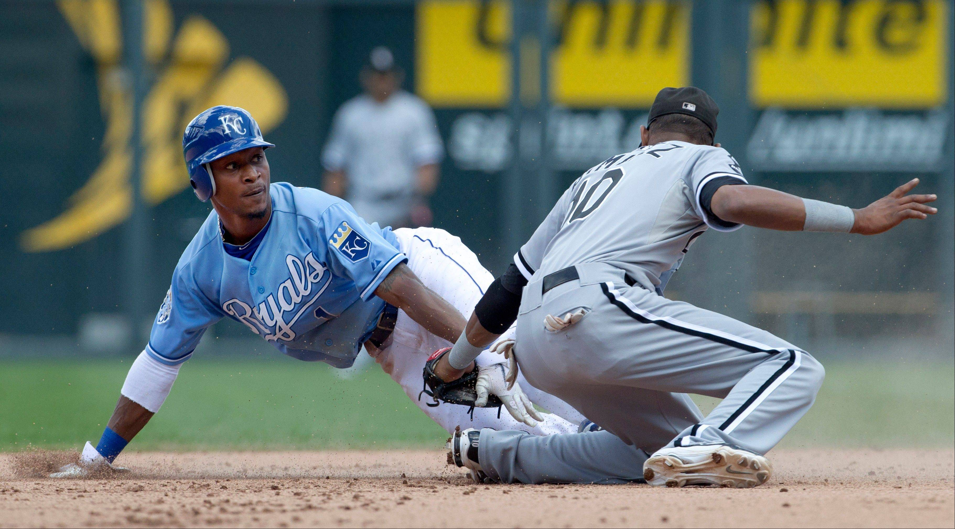 The Kansas City Royals' Jarrod Dyson beats the tag by White Sox shortstop Alexei Ramirez during Sunday's eighth inning in Kansas City.