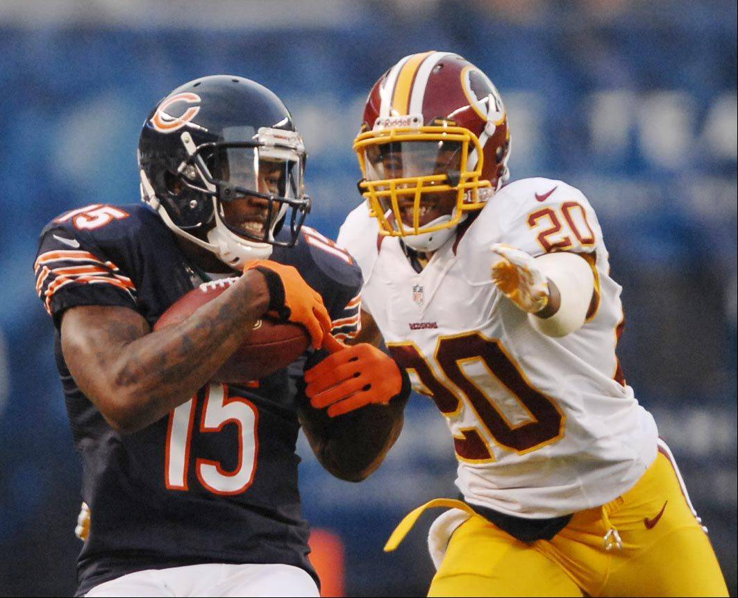 Chicago Bears wide receiver Brandon Marshall makes a catch for a first down as Washington Redskins defensive back Cedric Griffin covers Saturday in the second preseason game at Soldier Field in Chicago.