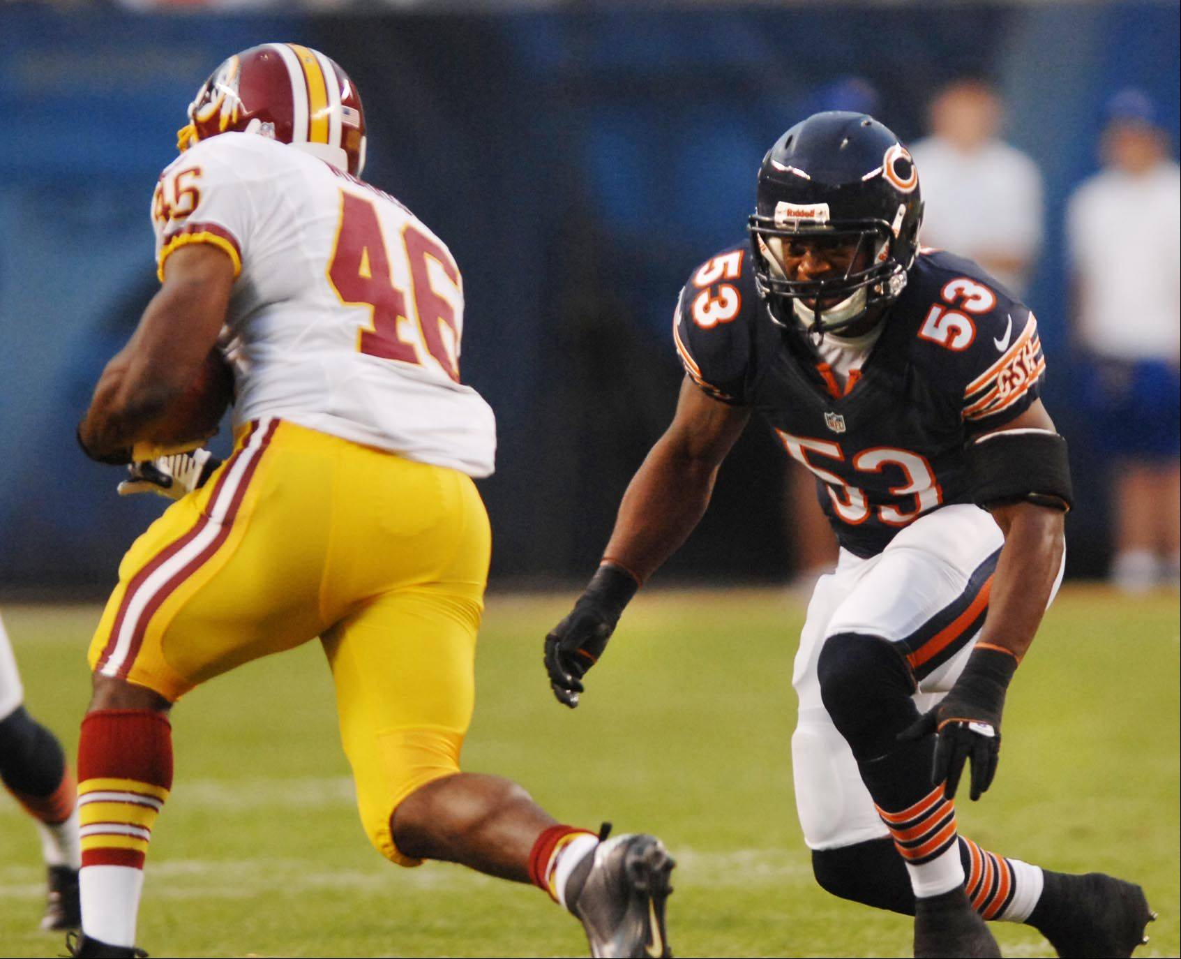 Chicago Bears linebacker Nick Roach lines up Washington Redskins running back Alfred Morris for a tackle Saturday in the second preseason game at Soldier Field in Chicago.